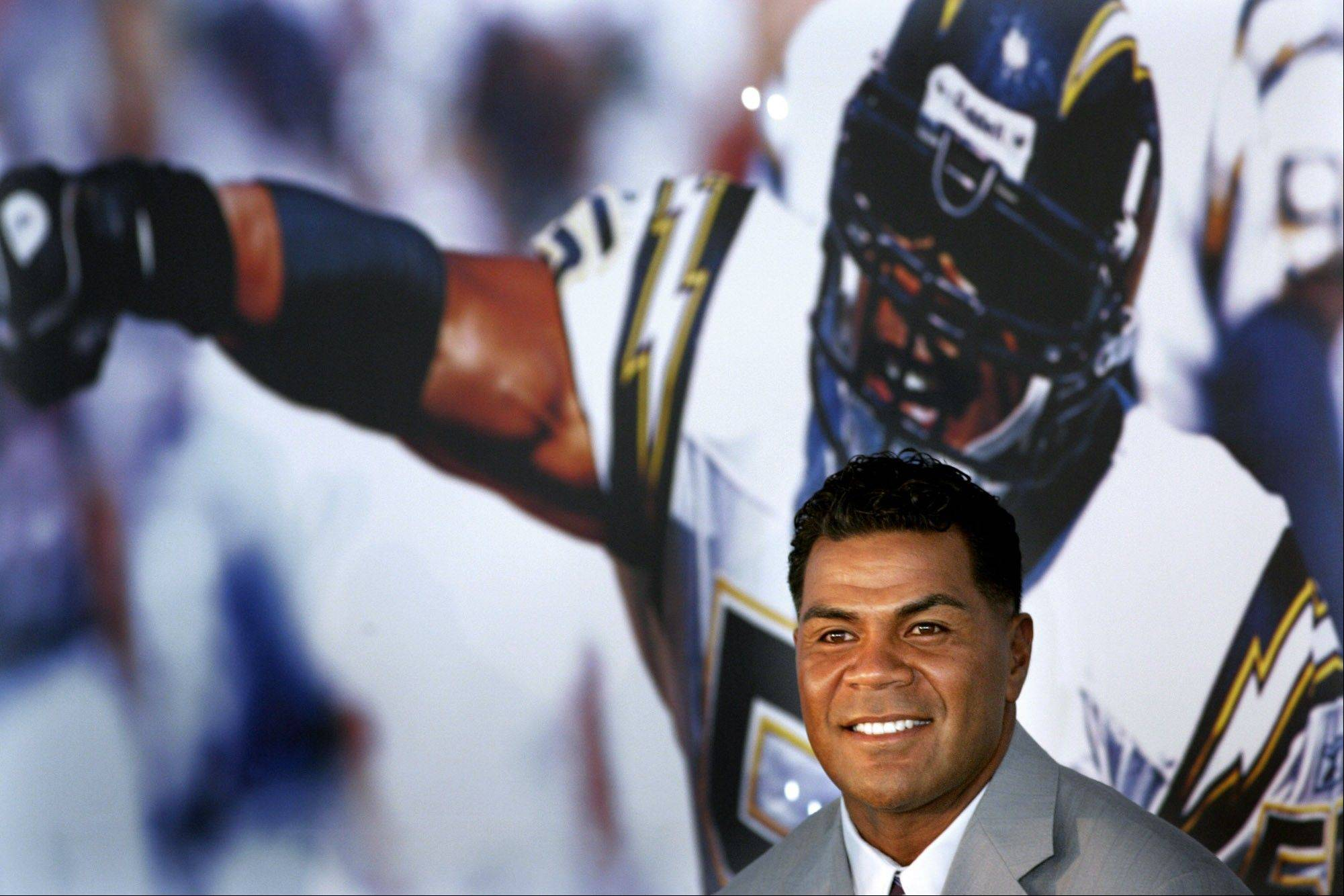 Junior Seau smiles, a former NFL star, was found dead at his home in Oceanside, Calif., on May 2. He was 43.