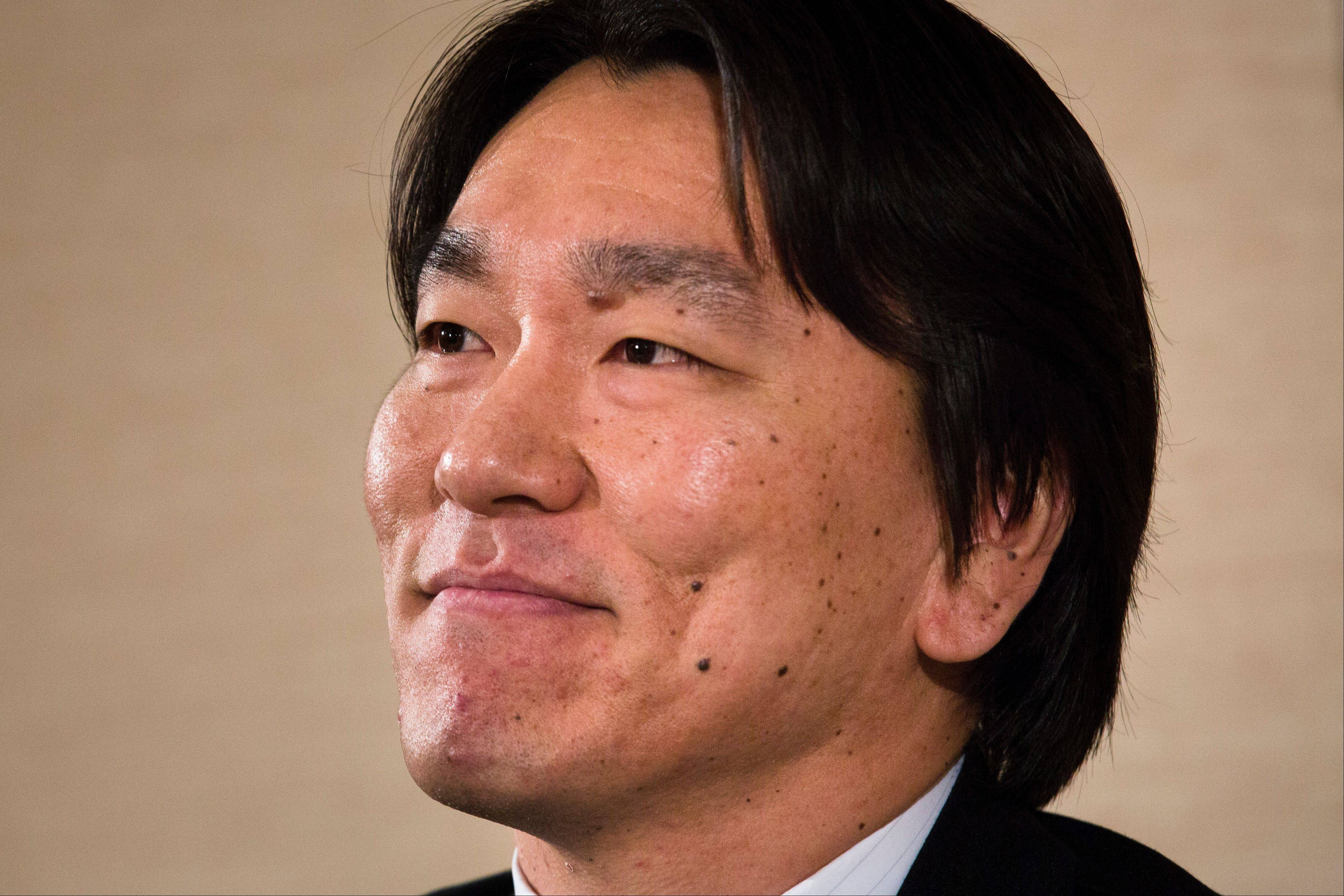 Baseball player Hideki Matsui smiles during a news conference to announce his retirement Thursday in New York.