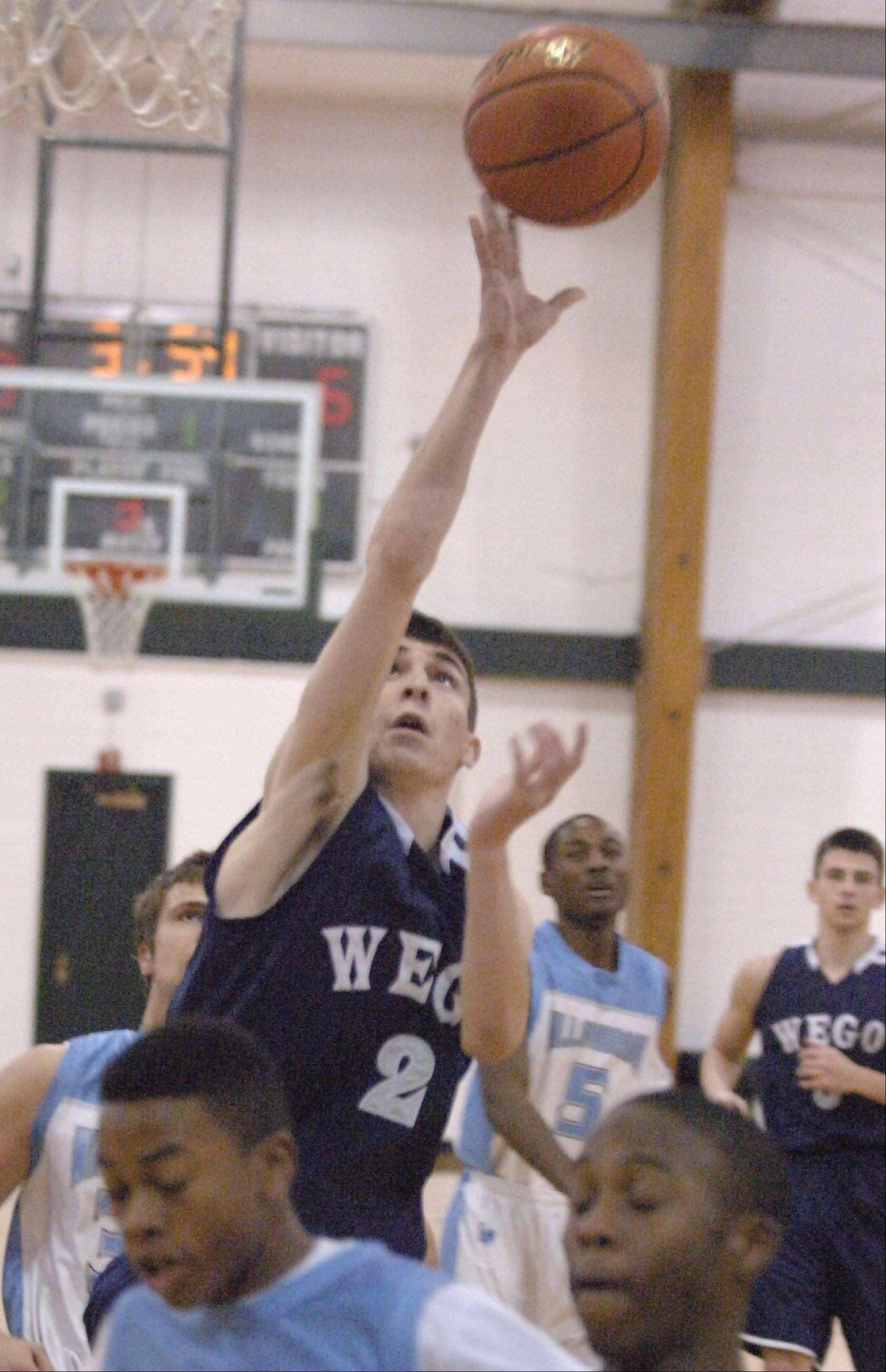 Jimmy Rizzo of West Chicago takes a shot during the West Chicago vs. Willowbrook boys basketball game at the Glenbard West Holiday Tournament Thursday.