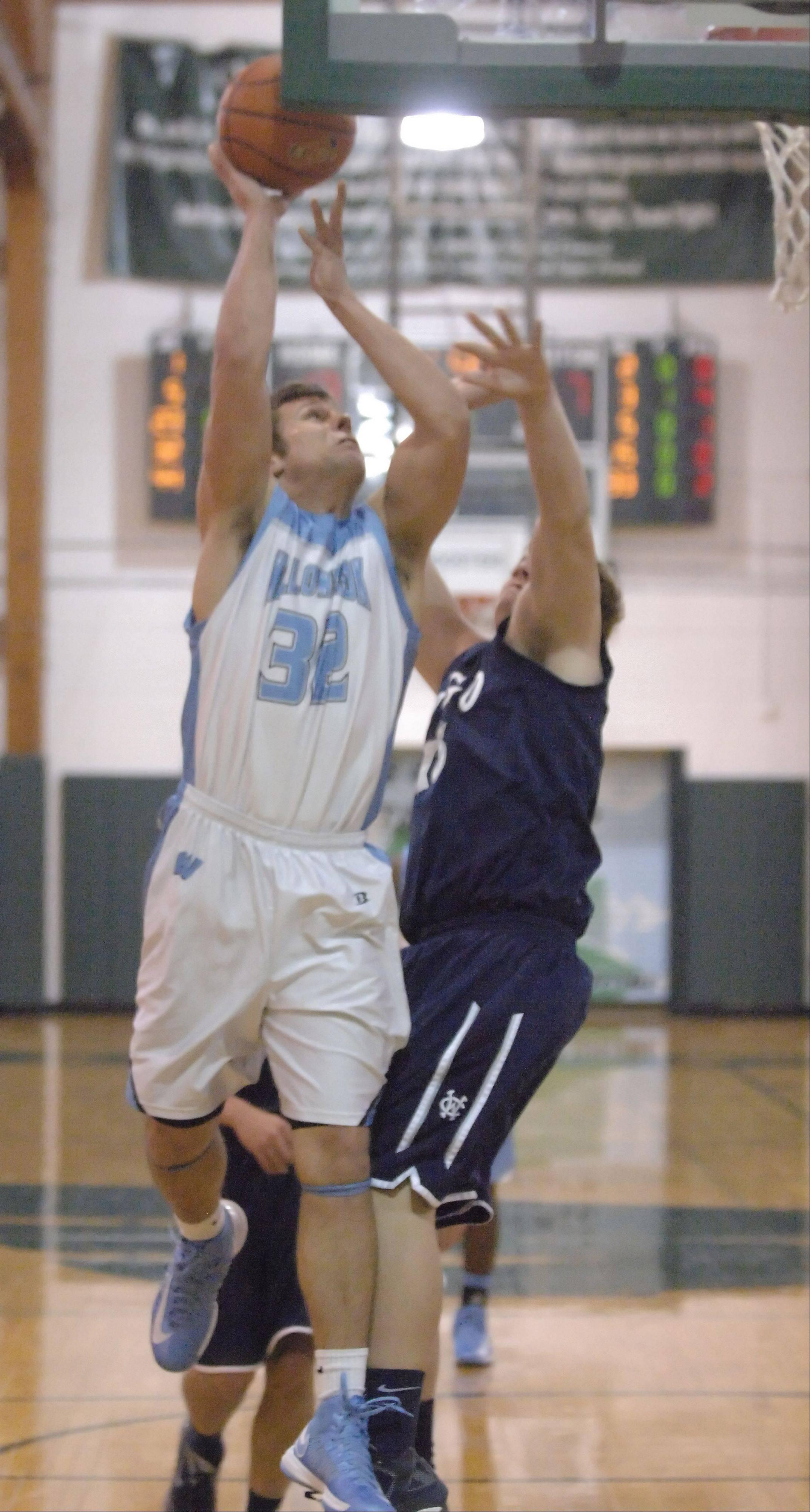 Nick Kilianek of Willowbrook brings the ball to the net during the West Chicago vs. Willowbrook boys basketball game at the Glenbard West Holiday Tournament Thursday.