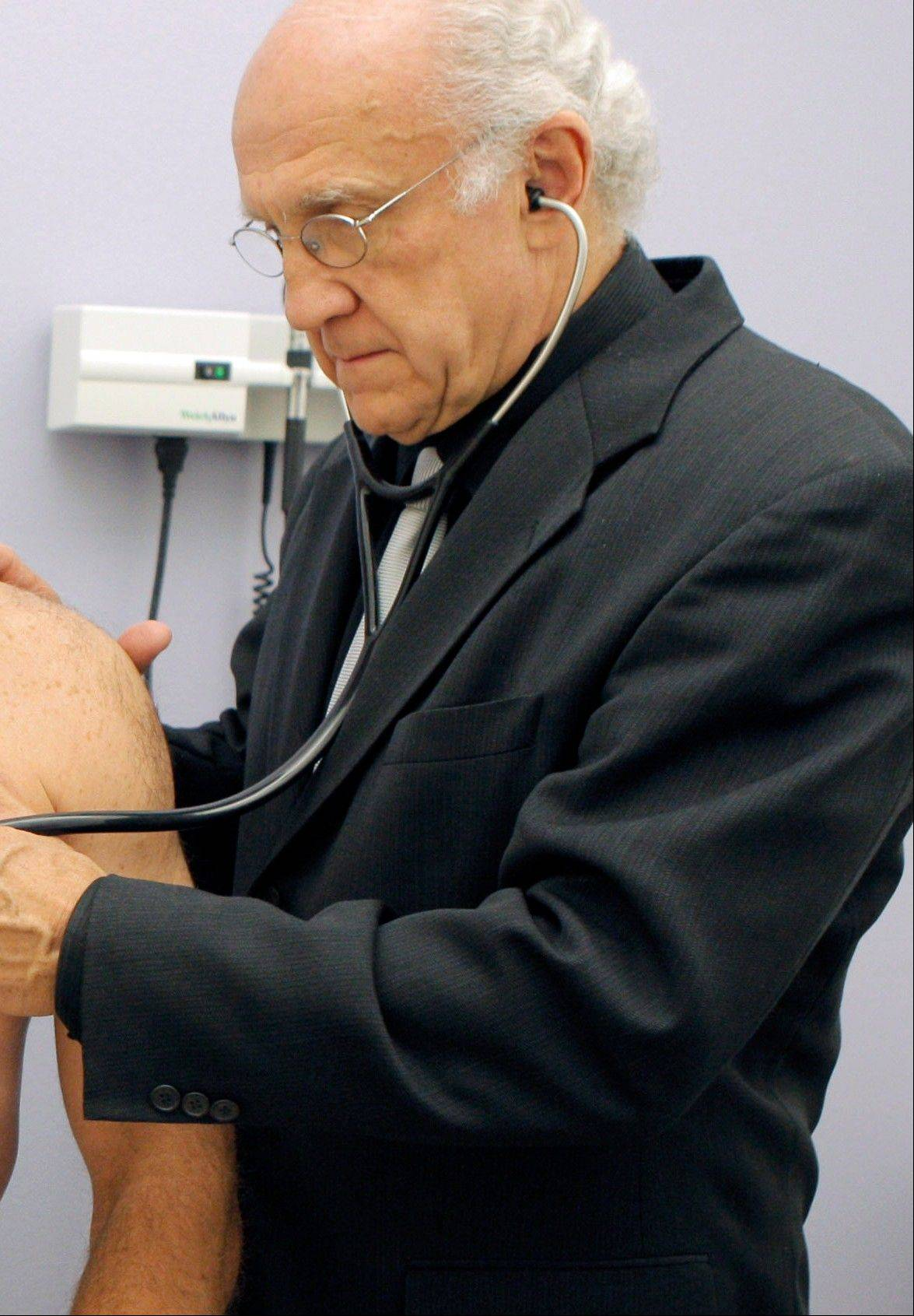 Dr. Mark Molitch of Northwestern University, who helped write medical standards meant to limit HGH treatment to legitimate patients, holds an injector pen that contains approximately a weeks worth of doses for a patient in need of the drug. An Associated Press investigation shows that a federal crackdown on illicit foreign supplies of human growth hormone has failed to stop rampant misuse.