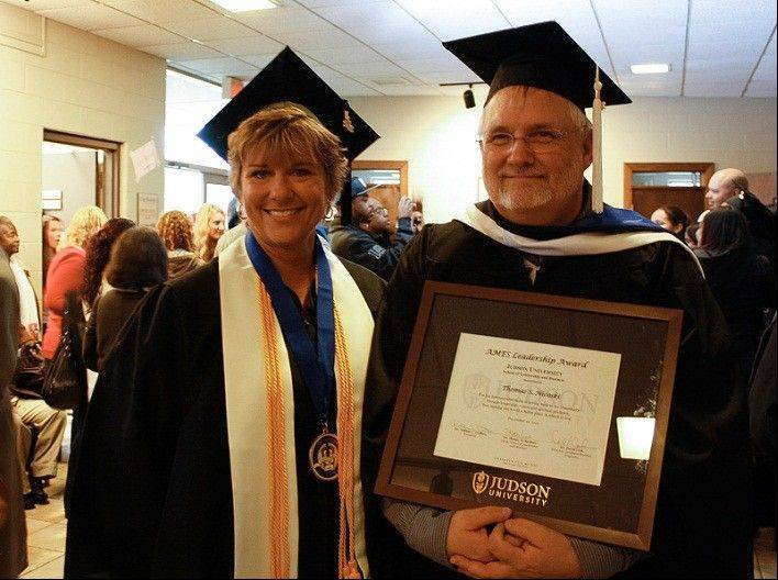 Judson University honors management and leadership graduate Denise Tassoni of Rockford with the President's Scholar Award and Thomas Nicoski of St. Charles with the Ames Award, which recognizes a graduate from Judson's School of Leadership and Business.