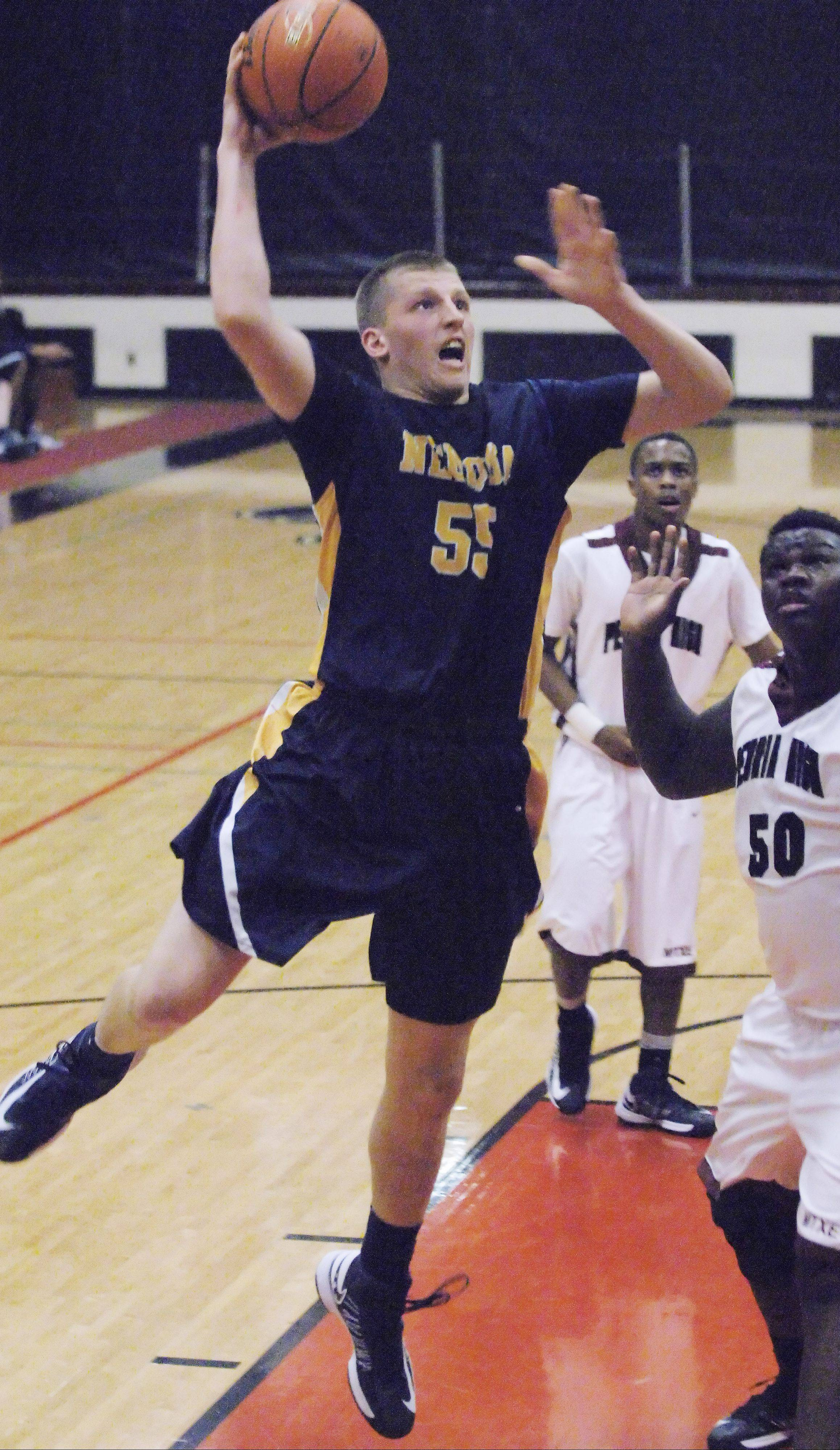Neuqua Valley�s Pat Kenny takes the ball to the hoop against Peoria Central on Friday at East Aurora.