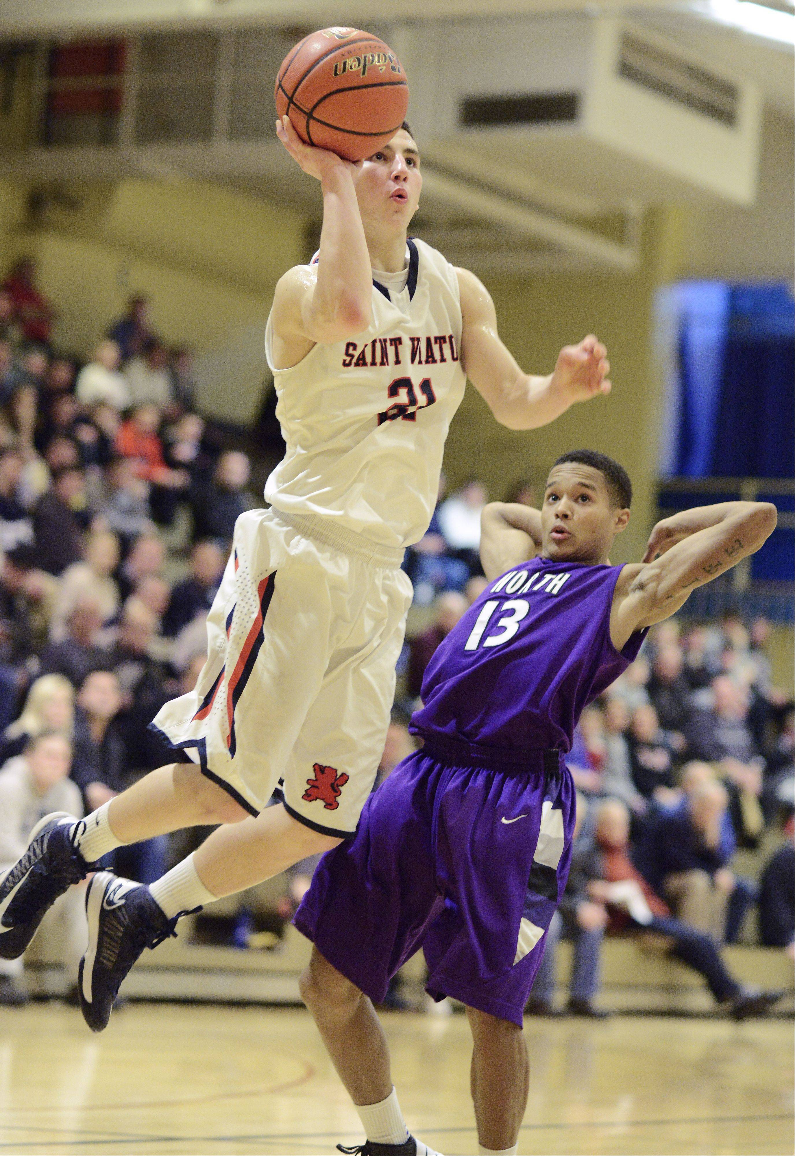 St. Viator�s Mark Falotico takes a jump shot as he moves past Niles North�s JJ Myles during Friday�s semifinal of the Wheeling Tournament.