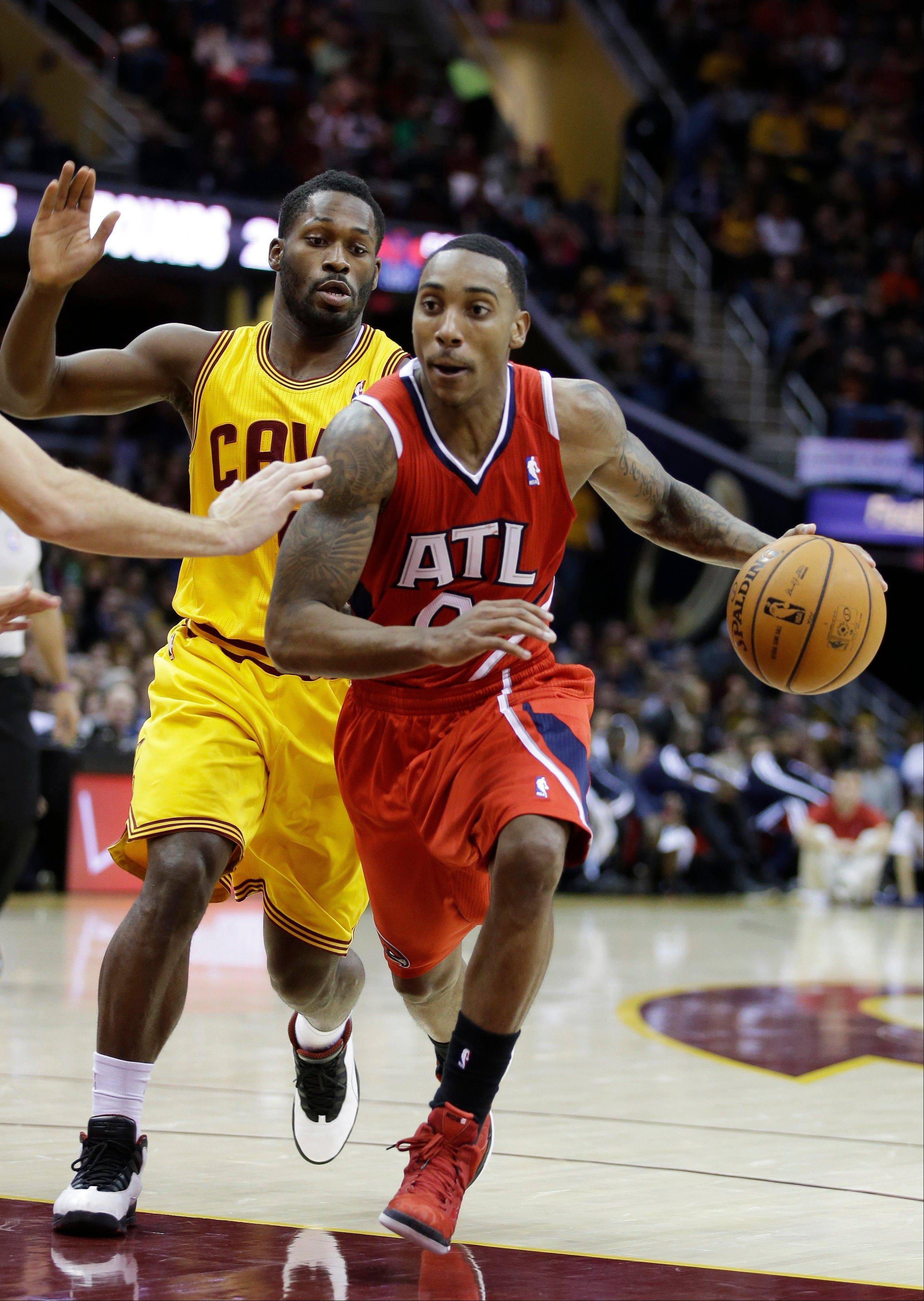 Atlanta�s Jeff Teague drives past the Cavaliers� Jeremy Pargo in the third quarter Friday in Cleveland. Teague led the Hawks with 27 points in a 102-94 win over the Cavaliers.