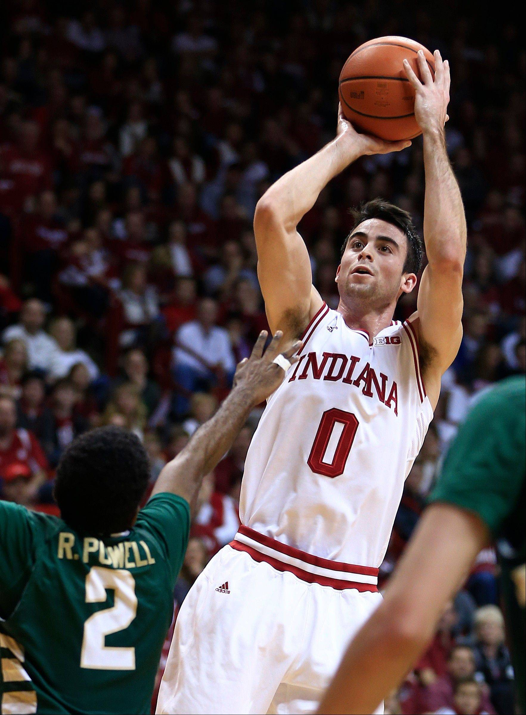 Indiana�s Will Sheehey puts up a shot against Jacksonville�s Russell Powell during the second half Friday in Bloomington, Ind.
