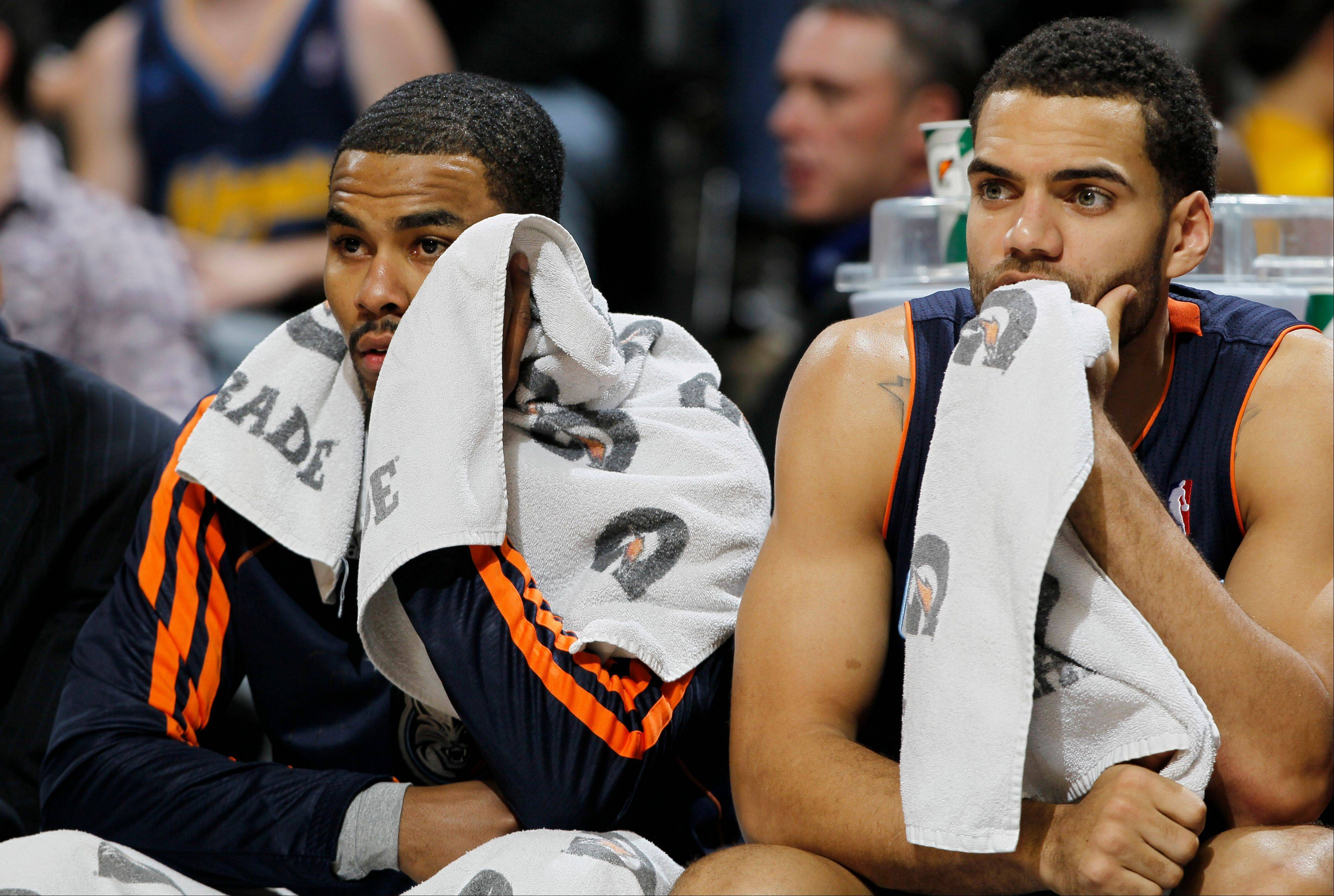Charlotte Bobcats guard Ramon Sessions, left, and rookie forward Jeff Taylor watch as time runs out in Denver�s 110-88 victory over the Bobcats last Saturday. Michael Jordan�s team, which has lost 16 straight games, plays Brooklyn tonight.