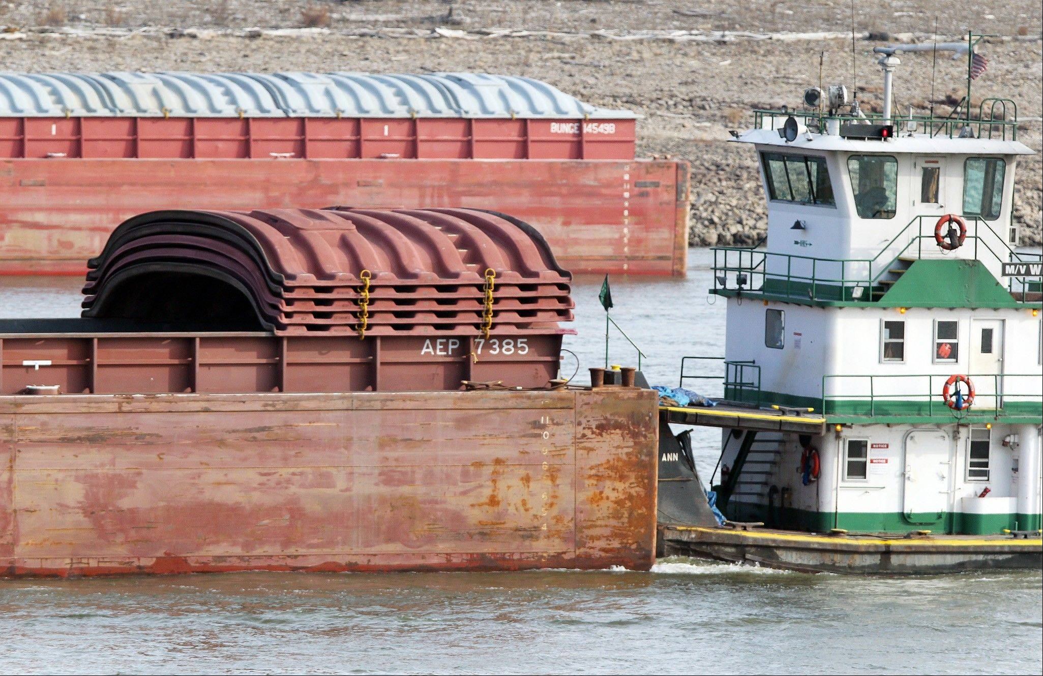 The towboat Wendy Ann moves an empty barge just north of the Martin Luther King Bridge in St. Louis.