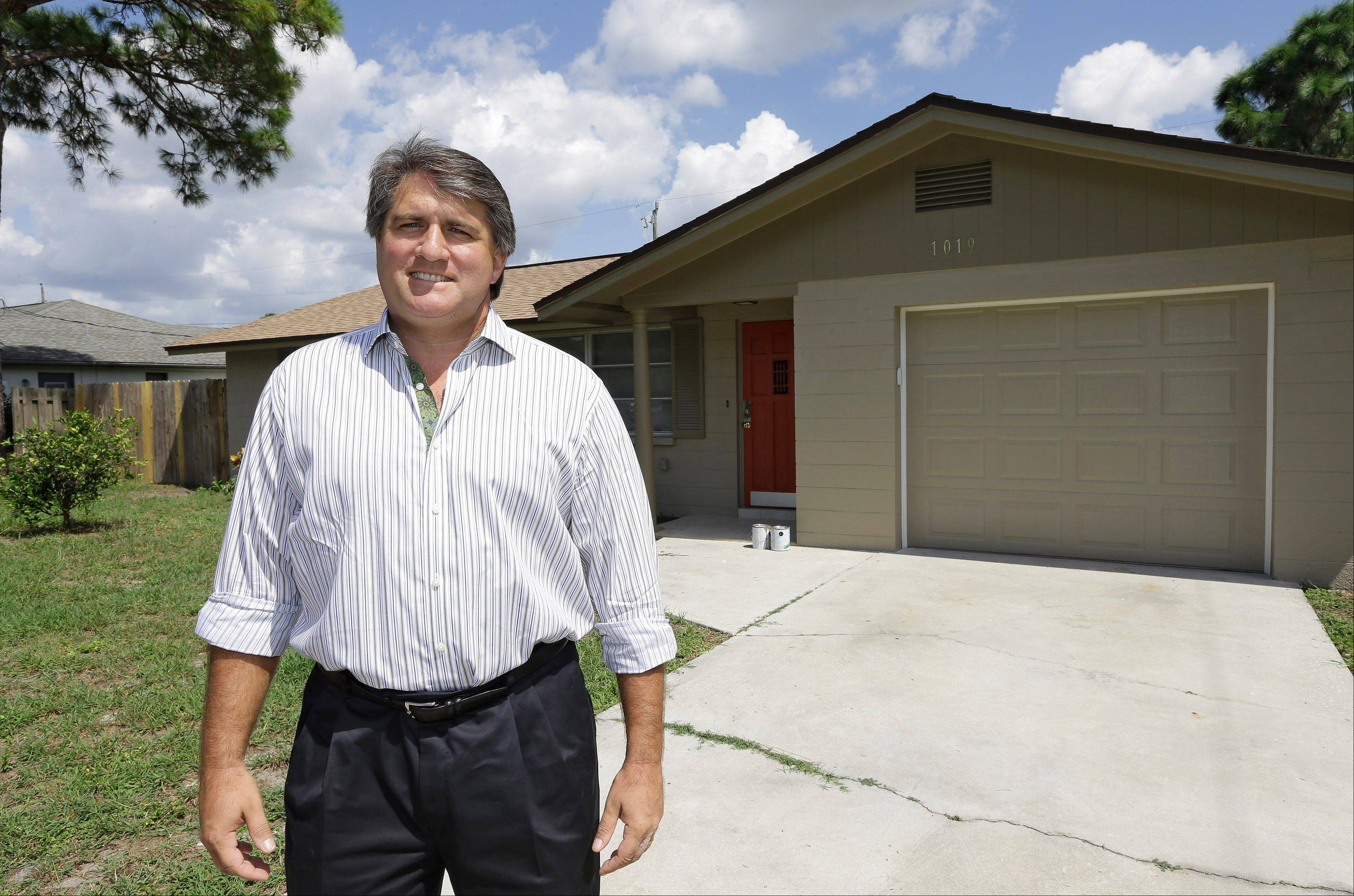 Andrew Neitlich in front of one his investment homes in Venice, Fla.