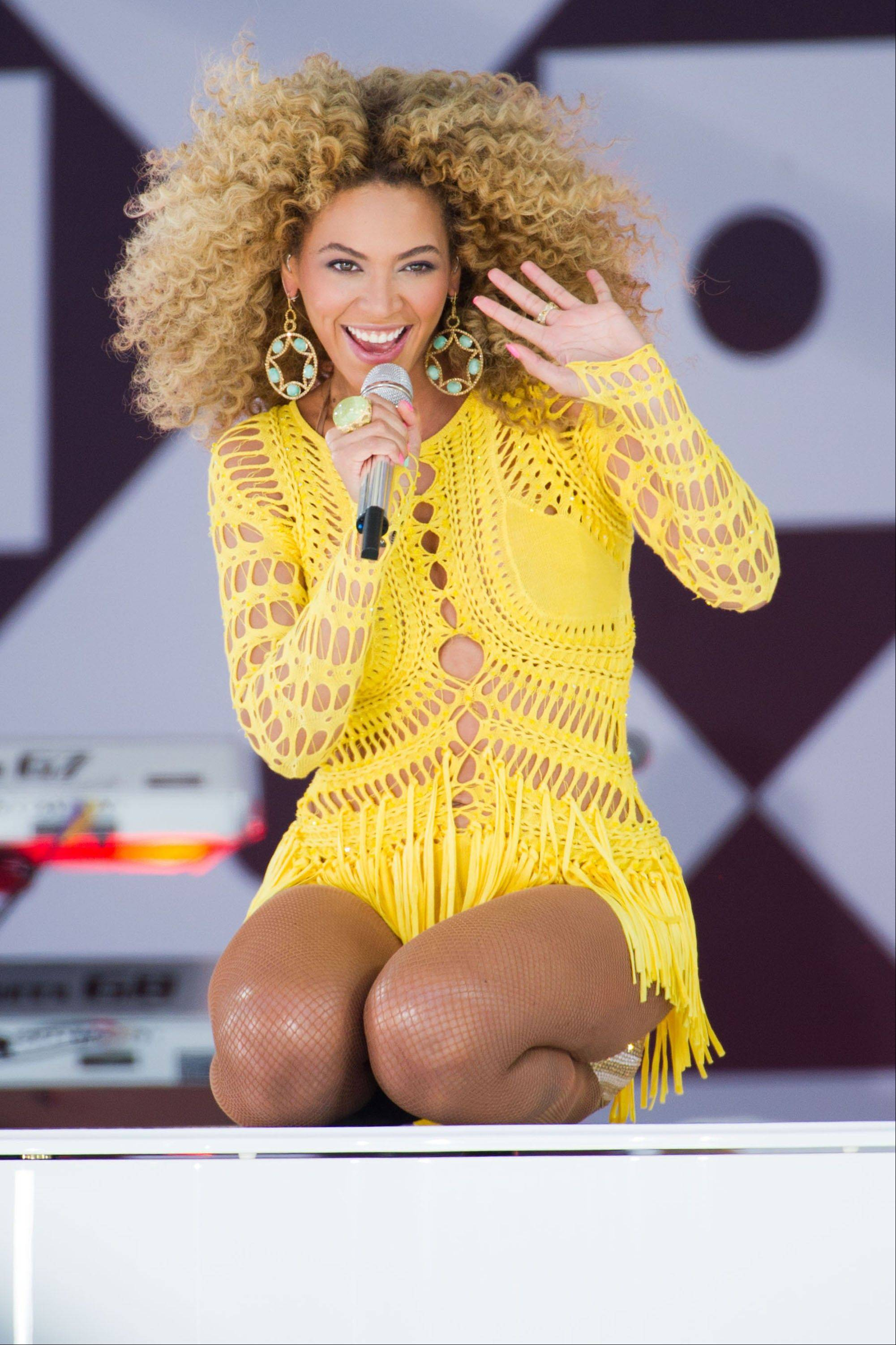 Through a photo contest, 100 fans will join Beyonc� onstage during the singer's halftime show performance at the 2013 Super Bowl on Feb. 3.