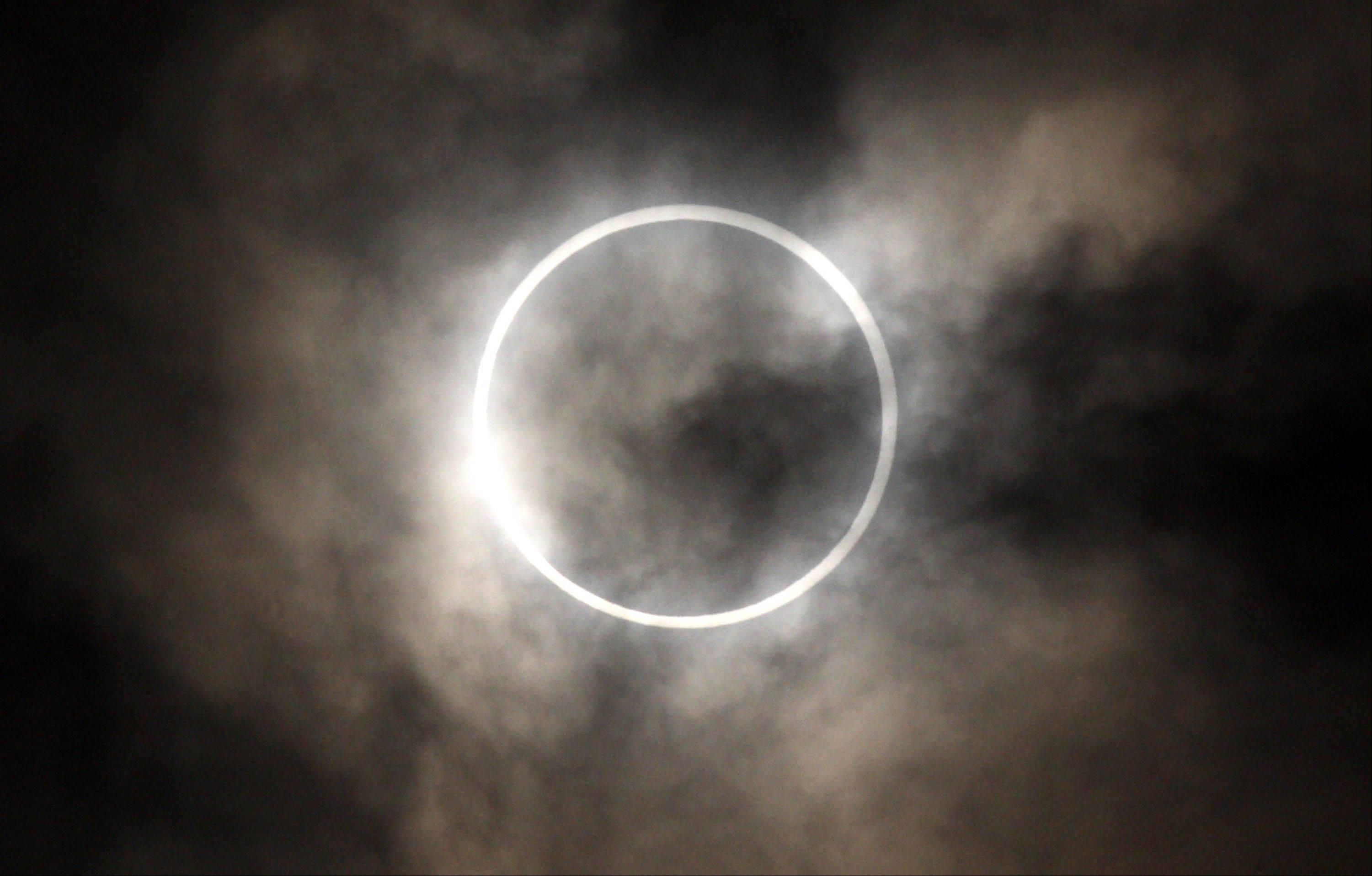 The sun is obscured by the moon during an annular solar eclipse in Tokyo, Japan, on Monday, May 21, 2012. An annular solar eclipse was observed in Japan today.