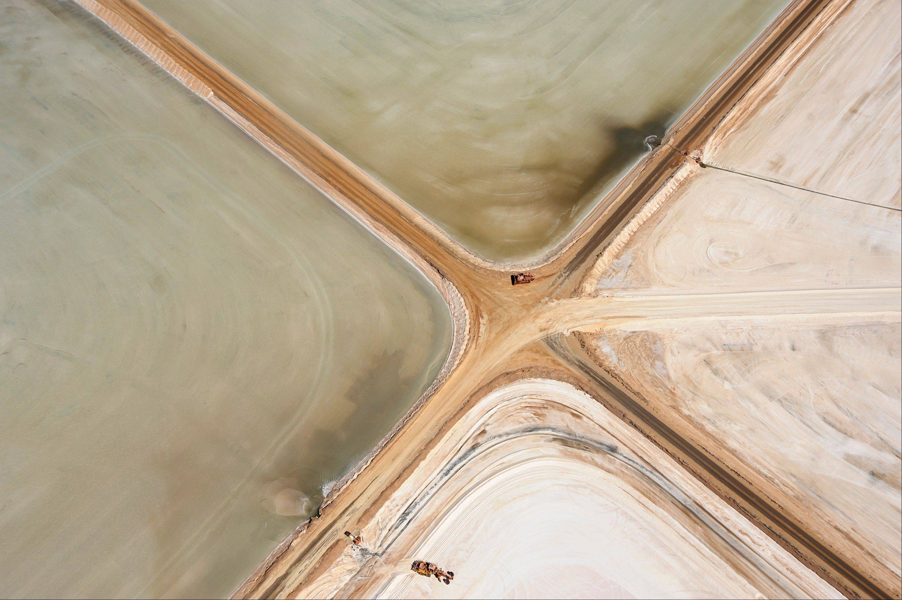 Roads intersect at a Rio Tinto Group salt operation in this aerial photograph taken over Dampier, Western Australia, on Monday, Aug. 20, 2012. Rio Tinto is the third-biggest mining company.