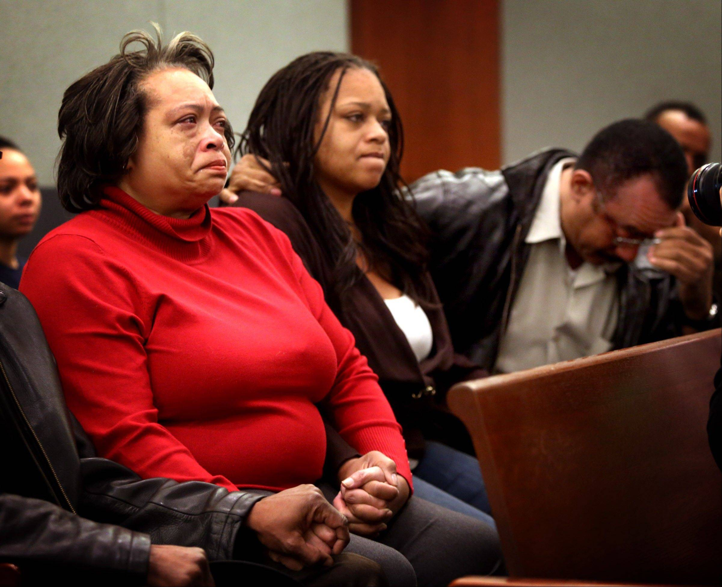 Claudette Flanagan-Jones, left, Jade Morris' grandmother, Tejuana Reeves-Morris, Jade's mother, and Andres Mack, Jade's grandfather, sit while Brenda Stokes Wilson appears at Clark County Justice Court, Friday in Las Vegas. Wilson is accused of slashing a Bellagio blackjack dealer and is suspected of kidnapping and slaying 10-year-old Jade Morris. A judge raised bail for Wilson from $60,000 to $600,000 on Friday in light of expected murder charges to be filed Friday afternoon.