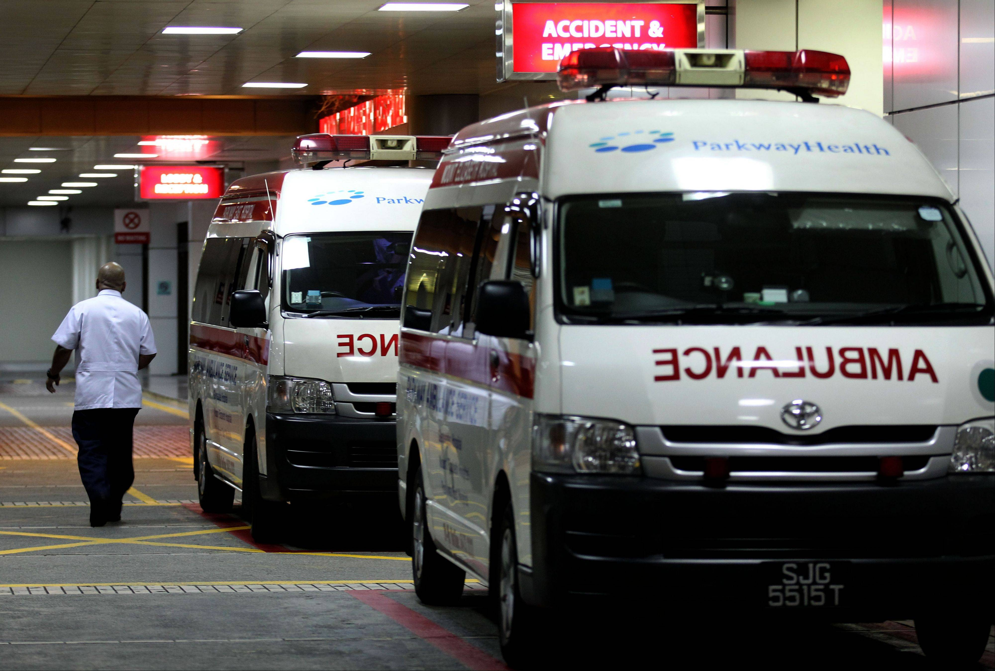 Ambulances are parked Friday outside the accident and emergency entrance at Mount Elizabeth Hospital in Singapore. After 10 days at a New Delhi hospital, the victim of a gang-rape in New Delhi was flown to Singapore on Thursday for treatment at the Mount Elizabeth hospital. She died early Saturday.