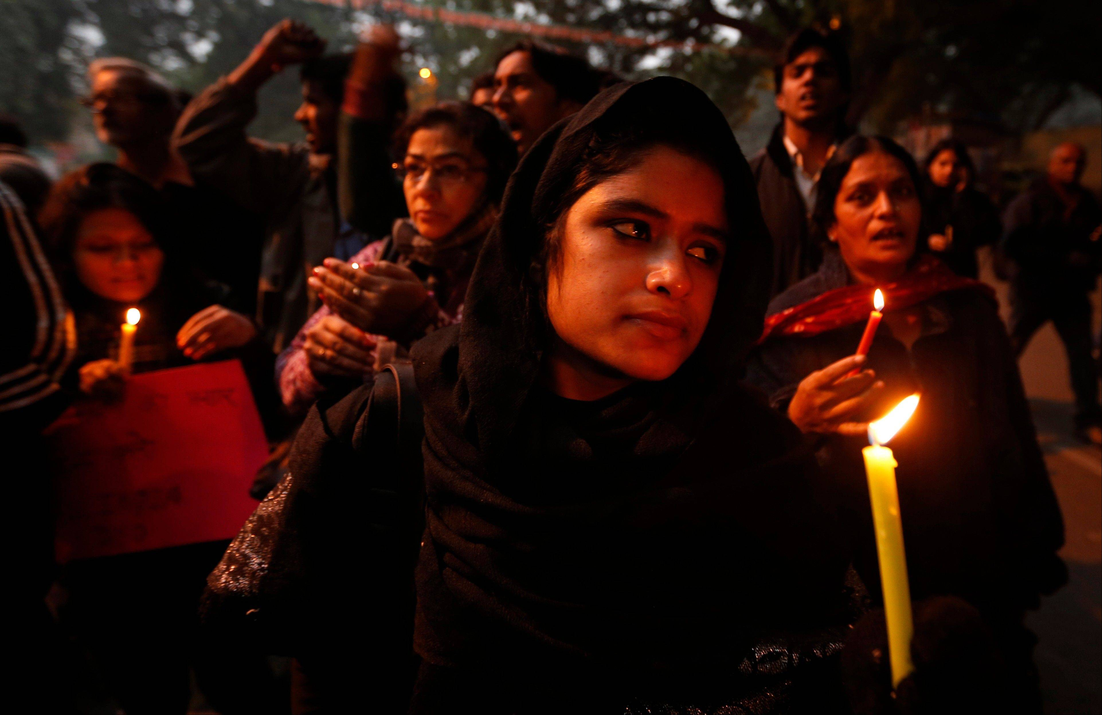 Indians participate Wednesday in a candle light vigil to seek a quick recovery of the young victim of the recent brutal gang-rape in a bus in New Delhi, India. A statement by Singapore�s Mount Elizabeth hospital, where the 23-year-old victim was being treated, said she died Saturday.