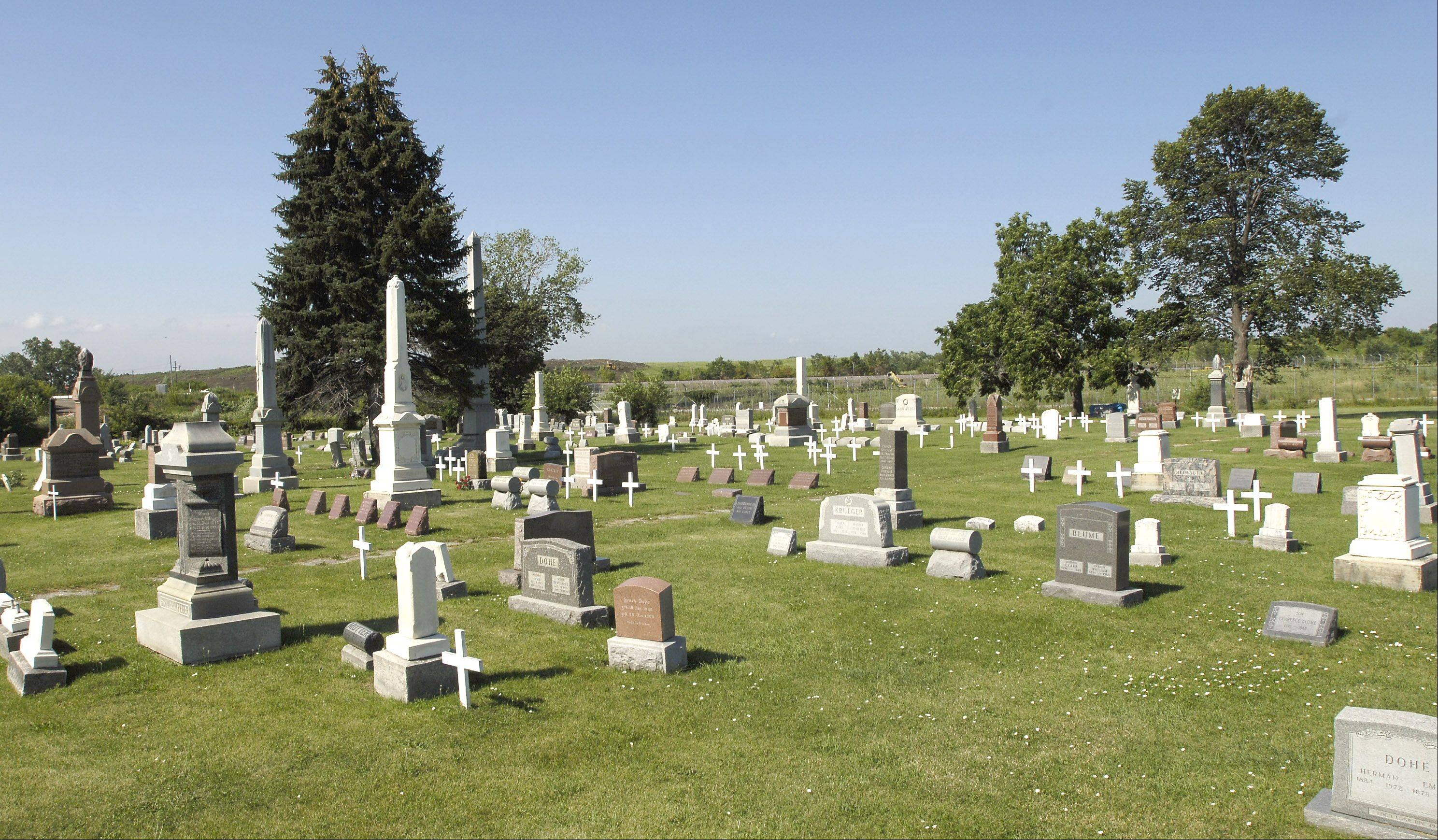 A Bensenville church that once operated the St. Johannes Cemetery near O'Hare International Airport was awarded $1.3 million in a settlement with the city of Chicago, which acquired the 5-acre site in 2010 as part of eminent domain proceedings.