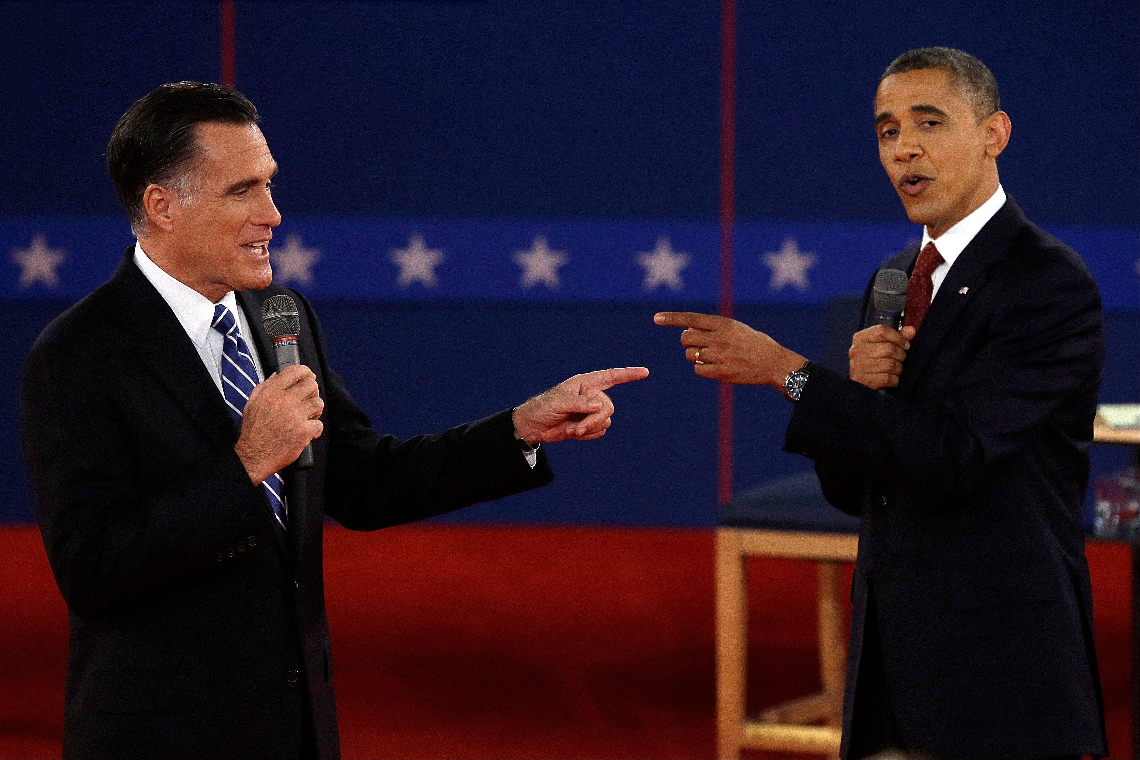 Republican presidential nominee Mitt Romney, left, and President Barack Obama spar during the second presidential debate at Hofstra University in Hempstead, N.Y.