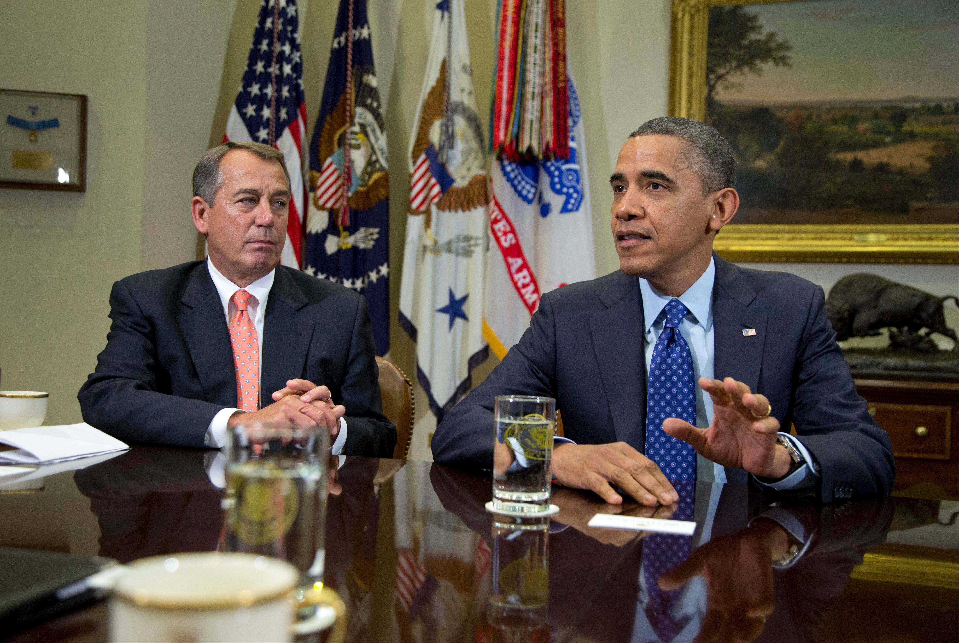 President Barack Obama, accompanied by House Speaker John Boehner of Ohio, speaks to reporters in the Roosevelt Room of the White House in Washington as he hosted a meeting of the bipartisan, bicameral leadership of Congress to discuss the deficit and economy.