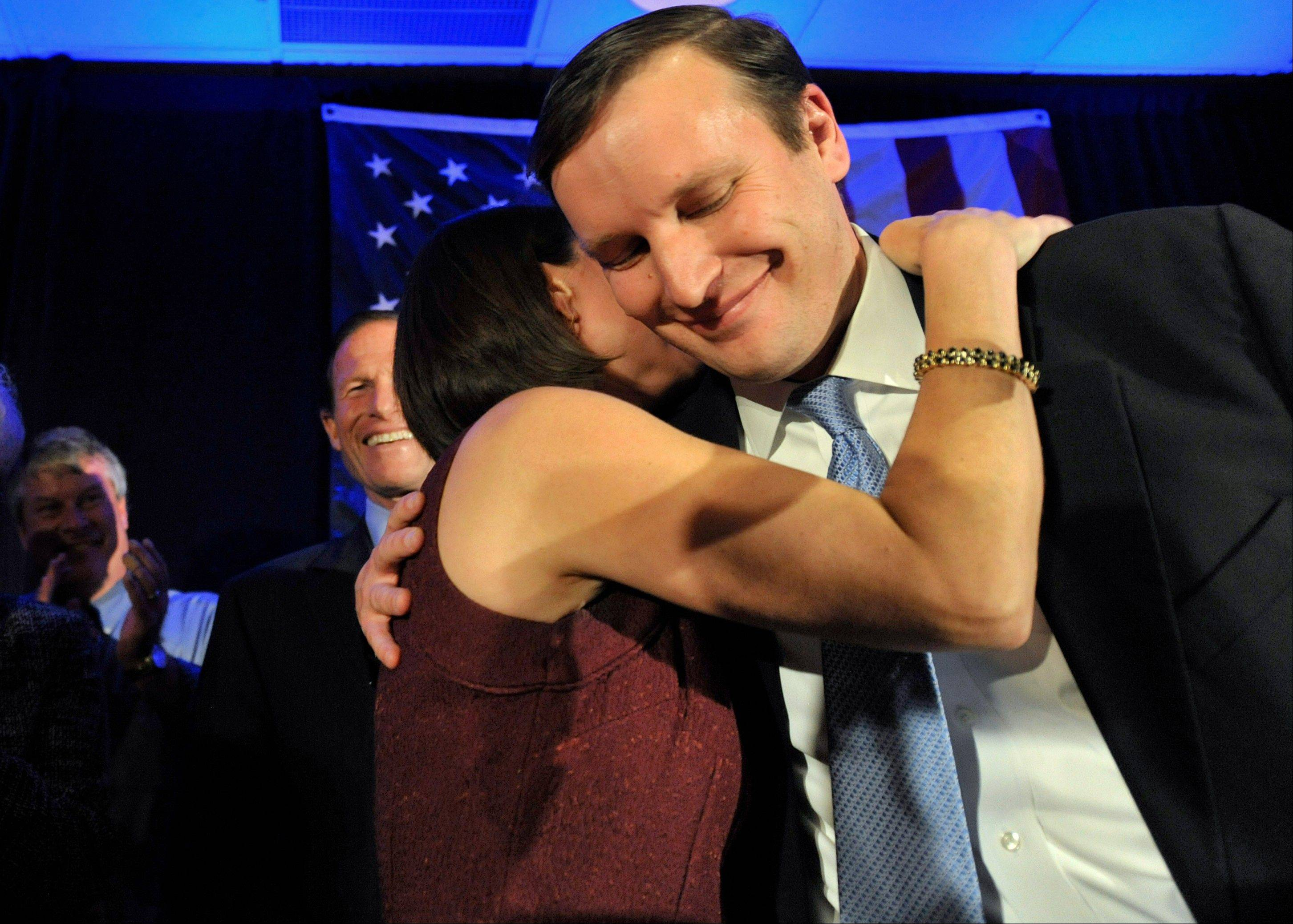 Newly elected Democratic Sen. Chris Murphy celebrates his win with wife Cathy Holahan Murphy over Republican Linda McMahon in Hartford, Conn. Murphy's election was one of Connecticut's top stories in 2012.