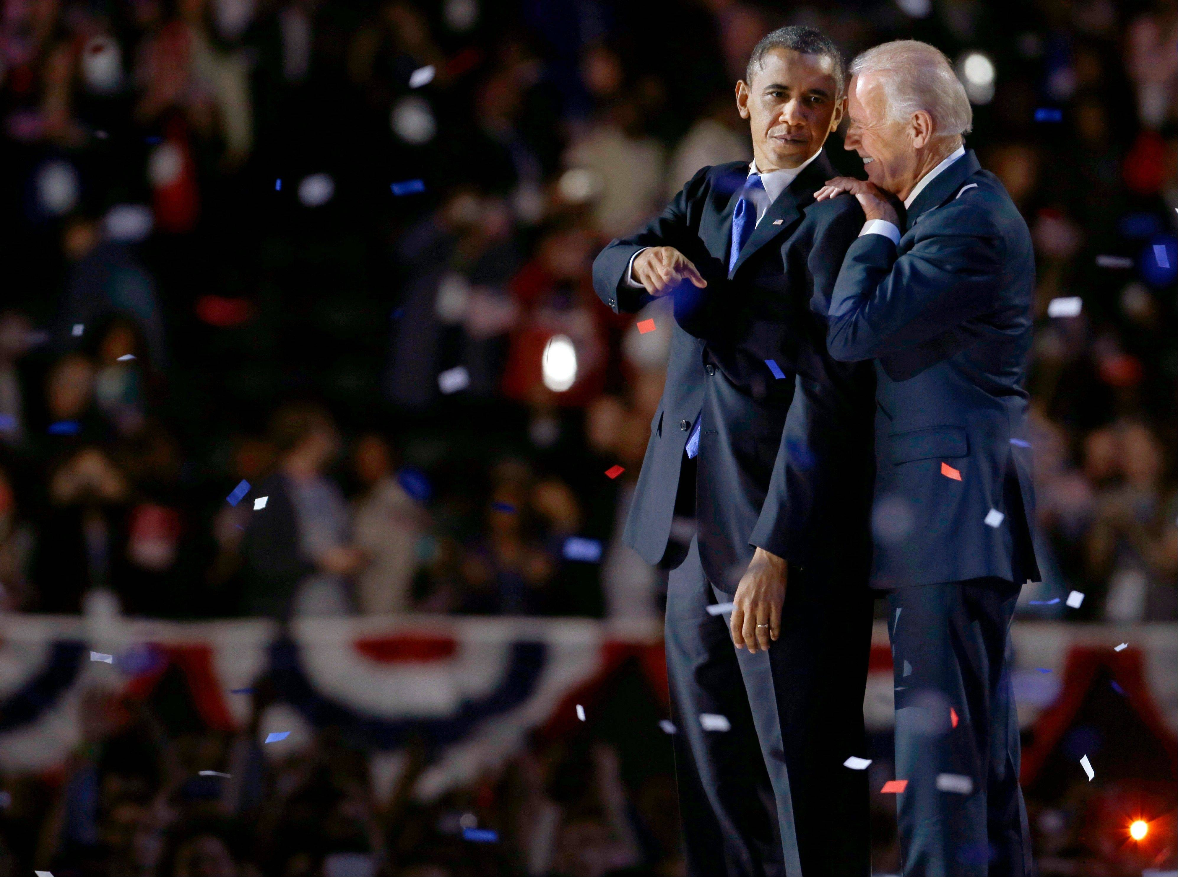 Vice President Joe Biden, right, talks to President Barack Obama at their election night party Wednesday, Nov. 7, 2012, in Chicago. President Obama's defeat of Republican challenger former Massachusetts Gov. Mitt Romney was voted the fourth most important news story in the AP's annual survey of its Illinois member editors and staff.