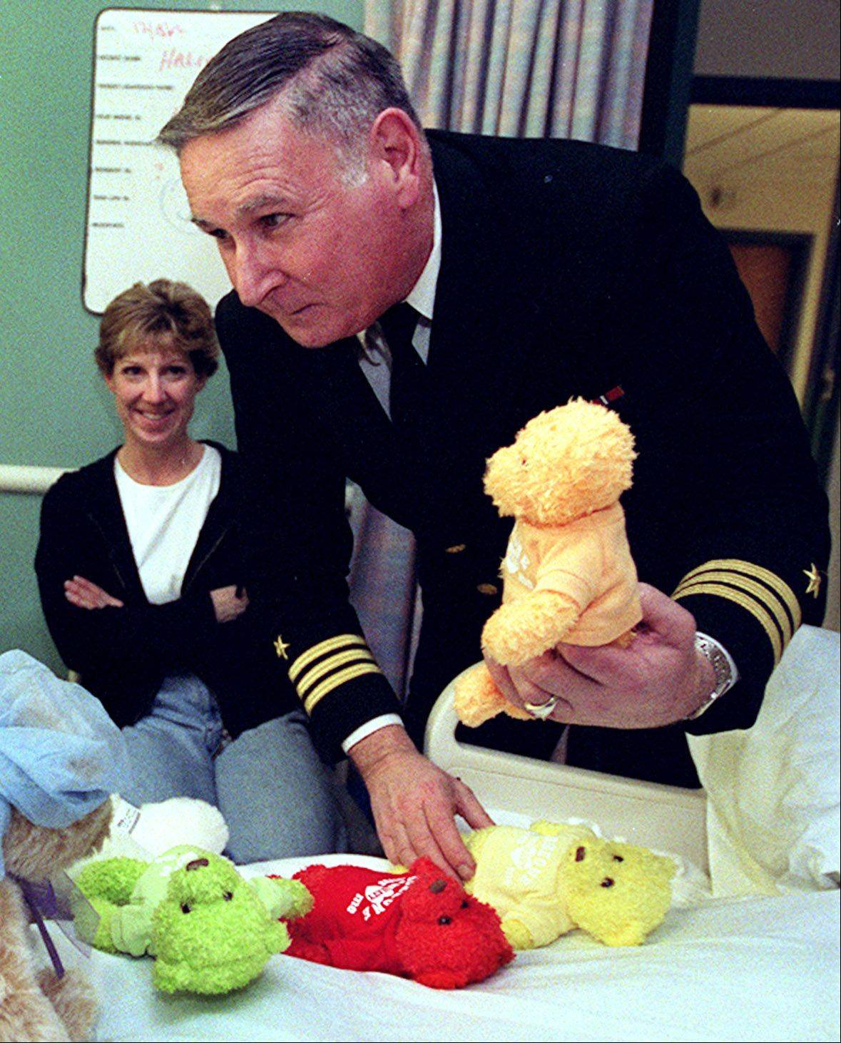 Bob Chwedyk/bchwedyk@dailyherald.com, 2002Douglas Challos, former Hawthorn Woods mayor and retired Navy commander, joined sailors on a visit to children at Advocate Lutheran General Hospital in Park Ridge in 2002. Challos, who also was a public affairs officer at Great Lakes Naval Station, died in 2012.