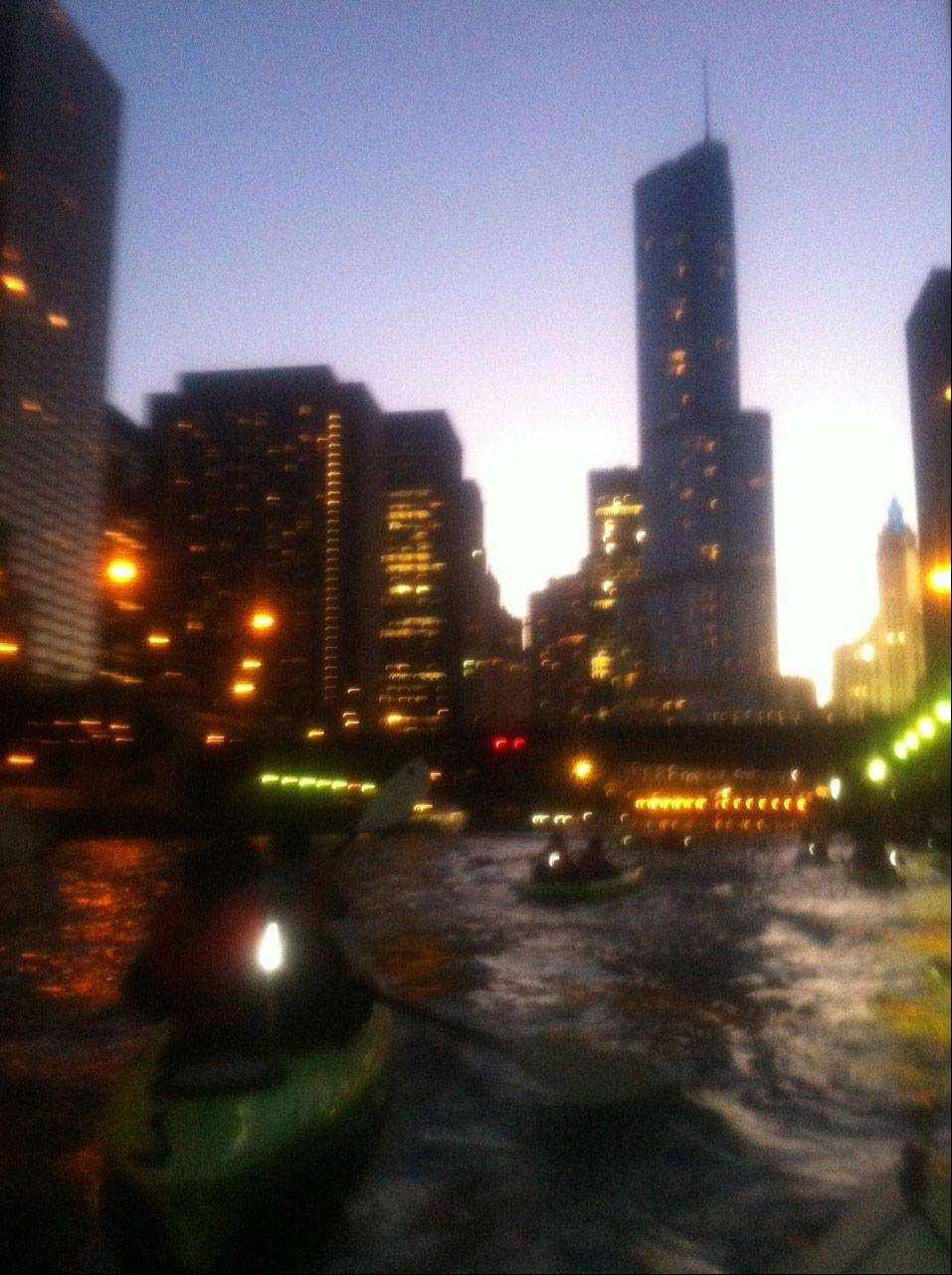 The lights of downtown Chicago can be seen while kayaking on the Chicago River.