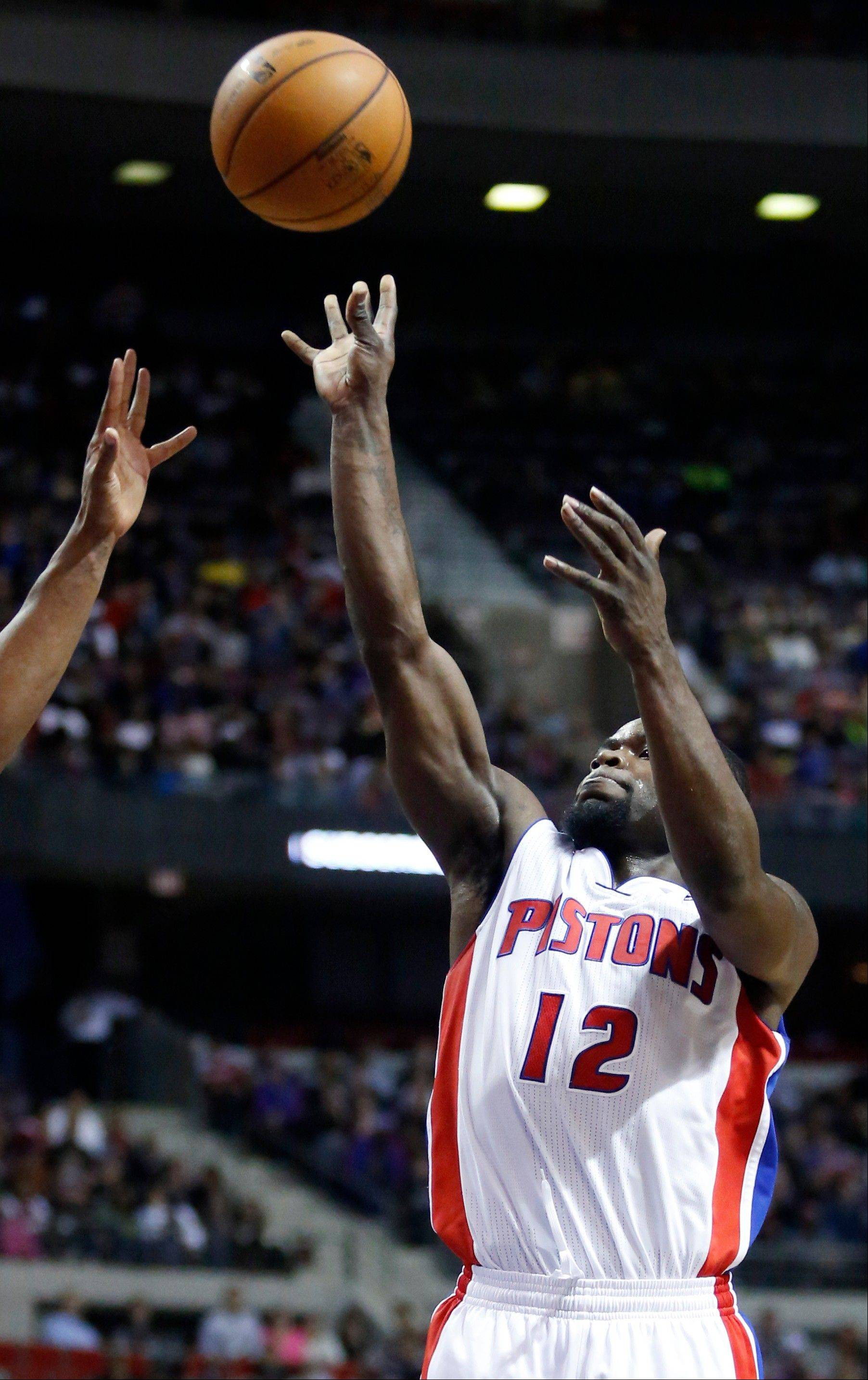 Detroit Pistons guard Will Bynum takes a shot against the Miami Heat in the second half Friday in Auburn Hills, Mich.