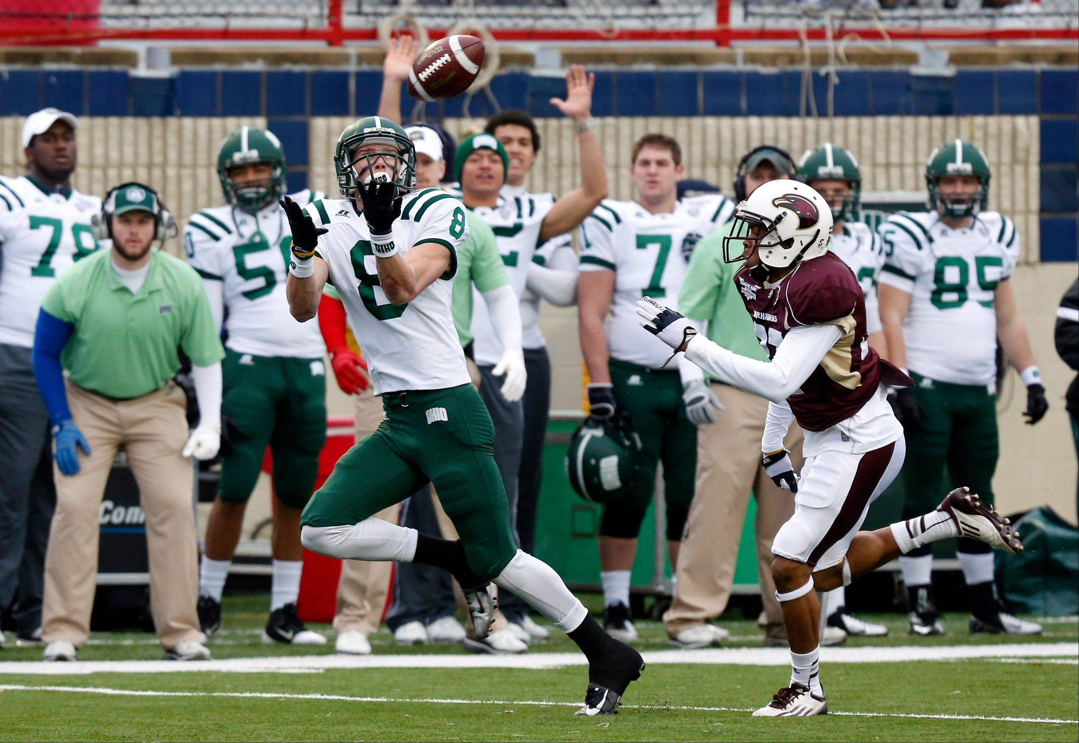 Ohio wide receiver Chase Cochran (8) catches a 68-yard touchdown pass in front of Louisiana-Monroe safety Mitch Lane (38) Friday during the first quarter of the Independence Bowl in Shreveport, La.