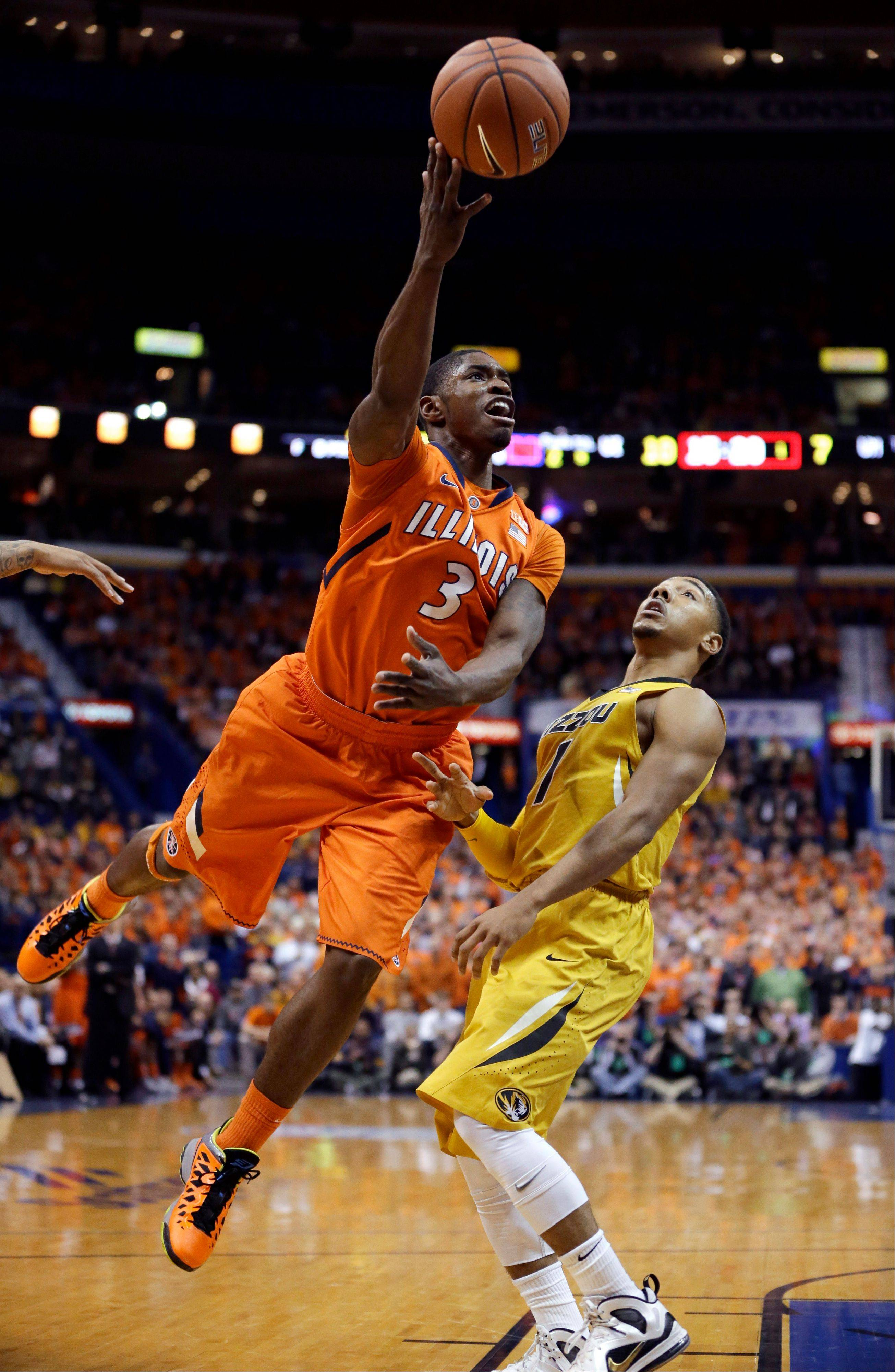 Illinois' Brandon Paul, left, heads to the basket as Missouri's Phil Pressey defends Saturday during the first half in St. Louis.