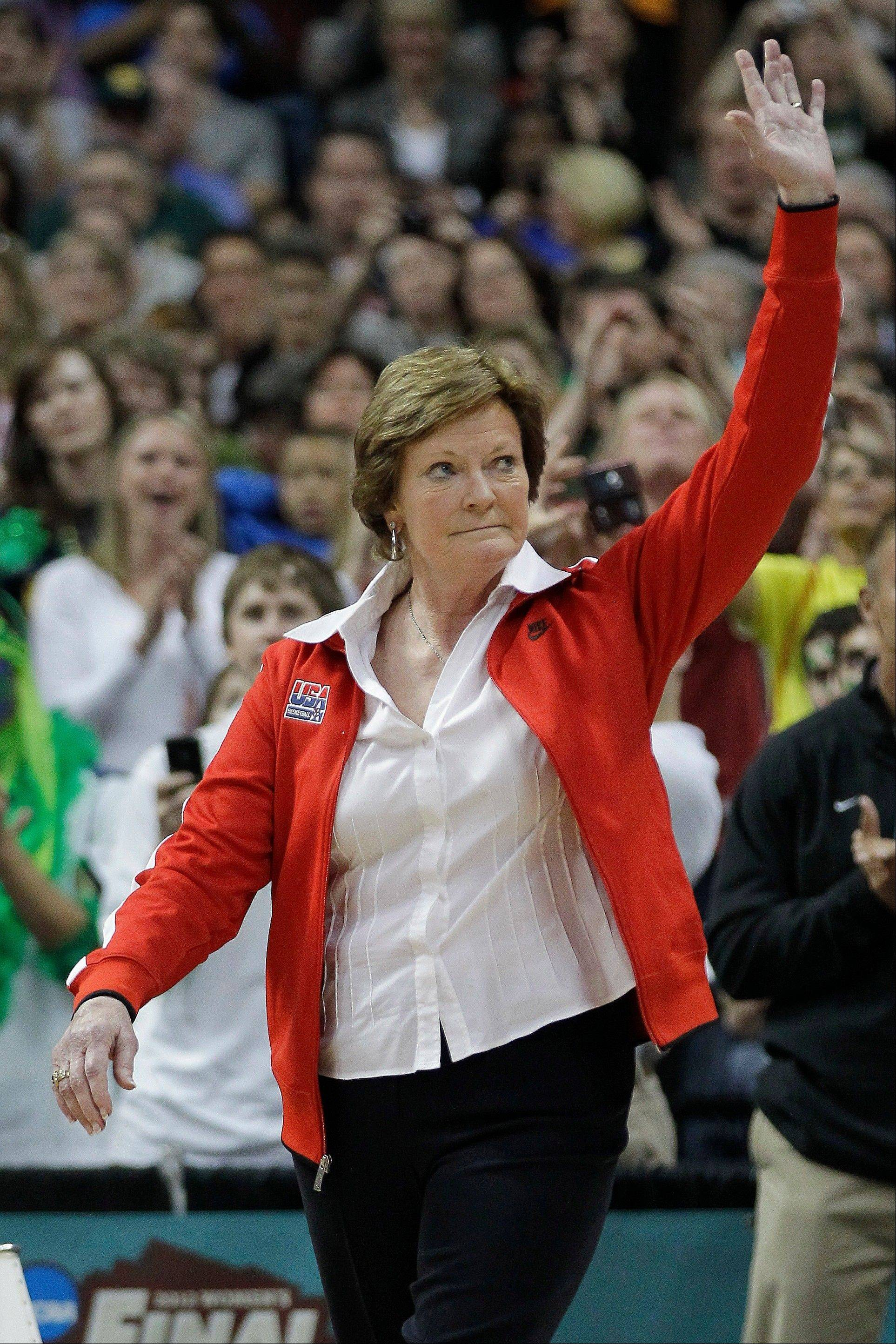 "Tennessee coach Pat Summitt waves to the crowd during a half-time ceremony to honor past olympic coaches at an NCAA women's Final Four semifinal college basketball game between the Baylor and the Stanford in Denver on April 18, 2012. Summitt, the sport's winningest coach, stepped aside as Tennessee's women's basketball coach and took the title of ""head coach emeritus."""