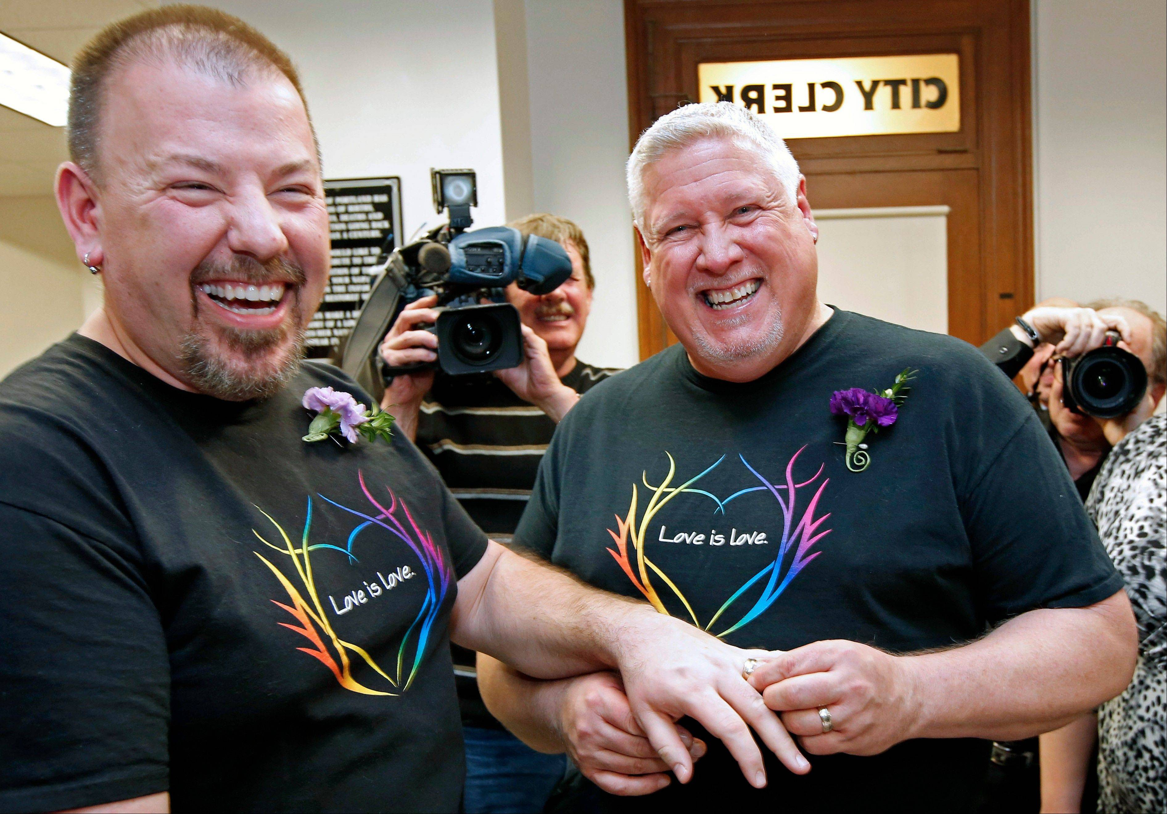 Steven Bridges, left, receives a wedding ring from Michael Snell, early Saturday, Dec. 29, at city hall in Portland, Maine. Same-sex couples in Maine are now legally allowed to marry under a new law that went into effect at 12:01 a.m. on Saturday.