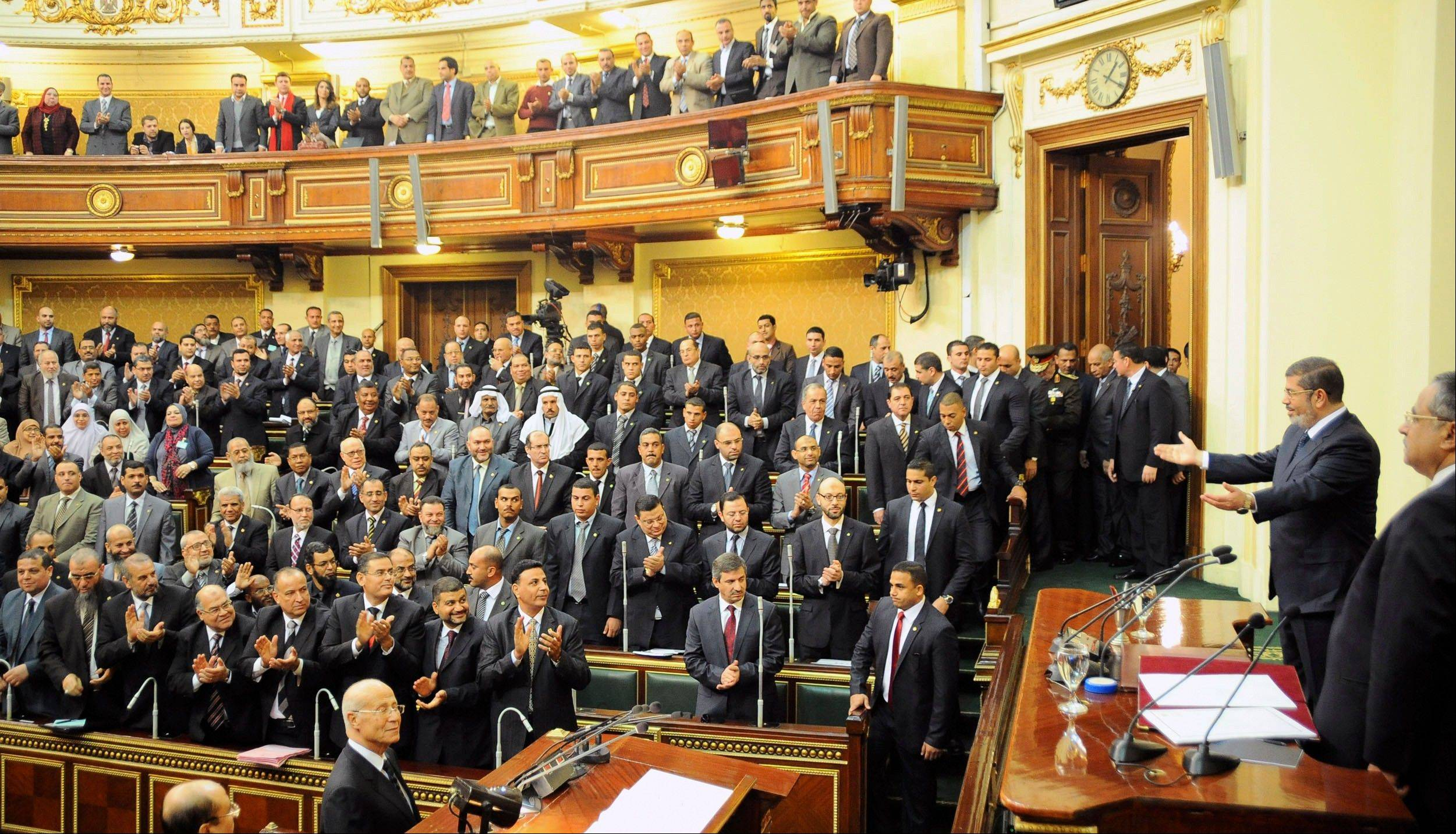 Mohammed Morsi addresses the newly convened upper house of parliament in Cairo, Egypt, Saturday, Dec. 29. Egypt�s Islamist president warned against any unrest that could harm the drive to repair the country�s battered economy in his first address before the newly convened upper house of parliament, urging the opposition to work with his government.