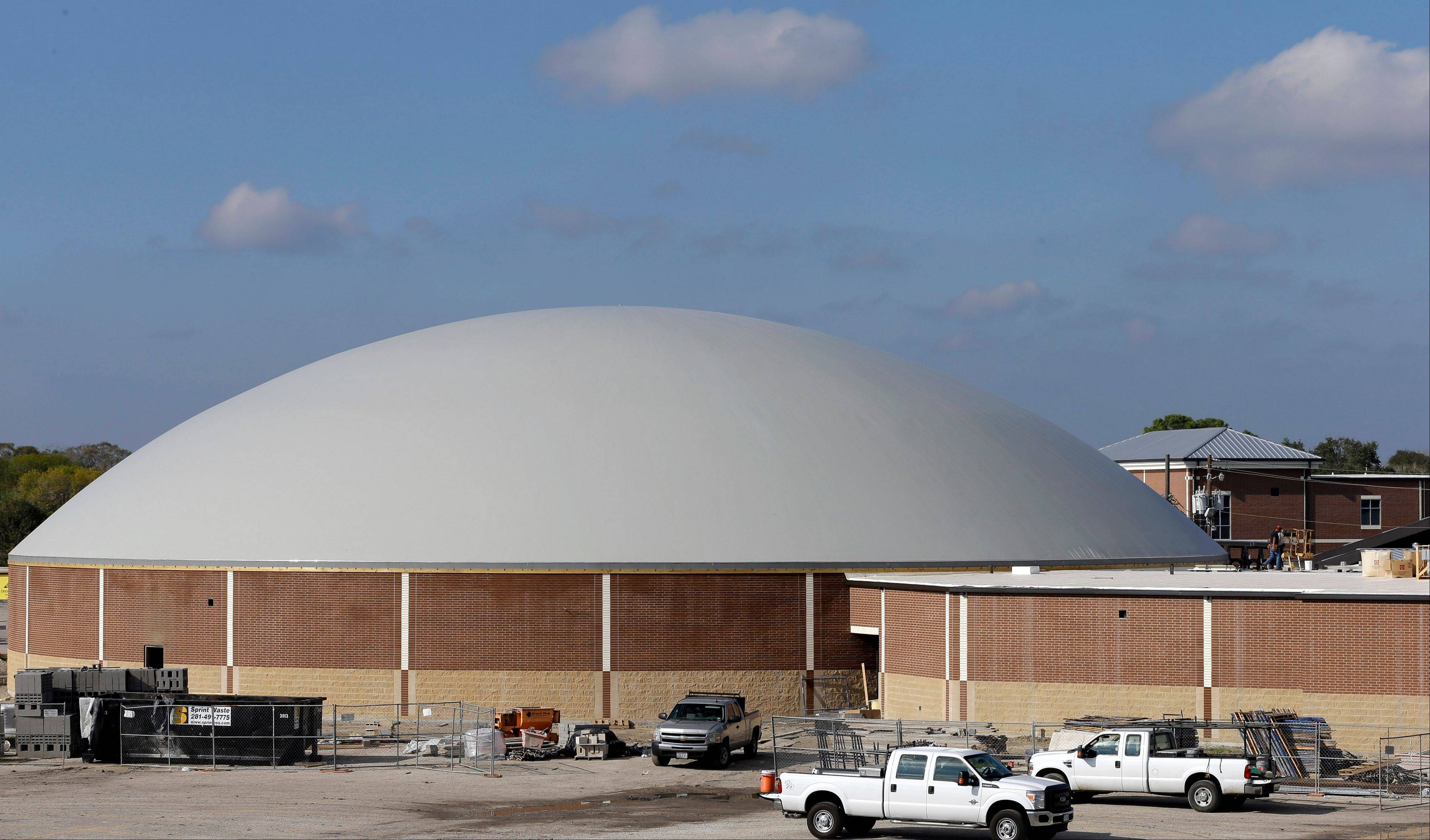 Work continues on the construction of a new domed gym at Edna High School in Edna, Texas. The hurricane dome, a structure being built in part with money from the Federal Emergency Management Agency, can be used to house first responders or residents evacuated during a storm.