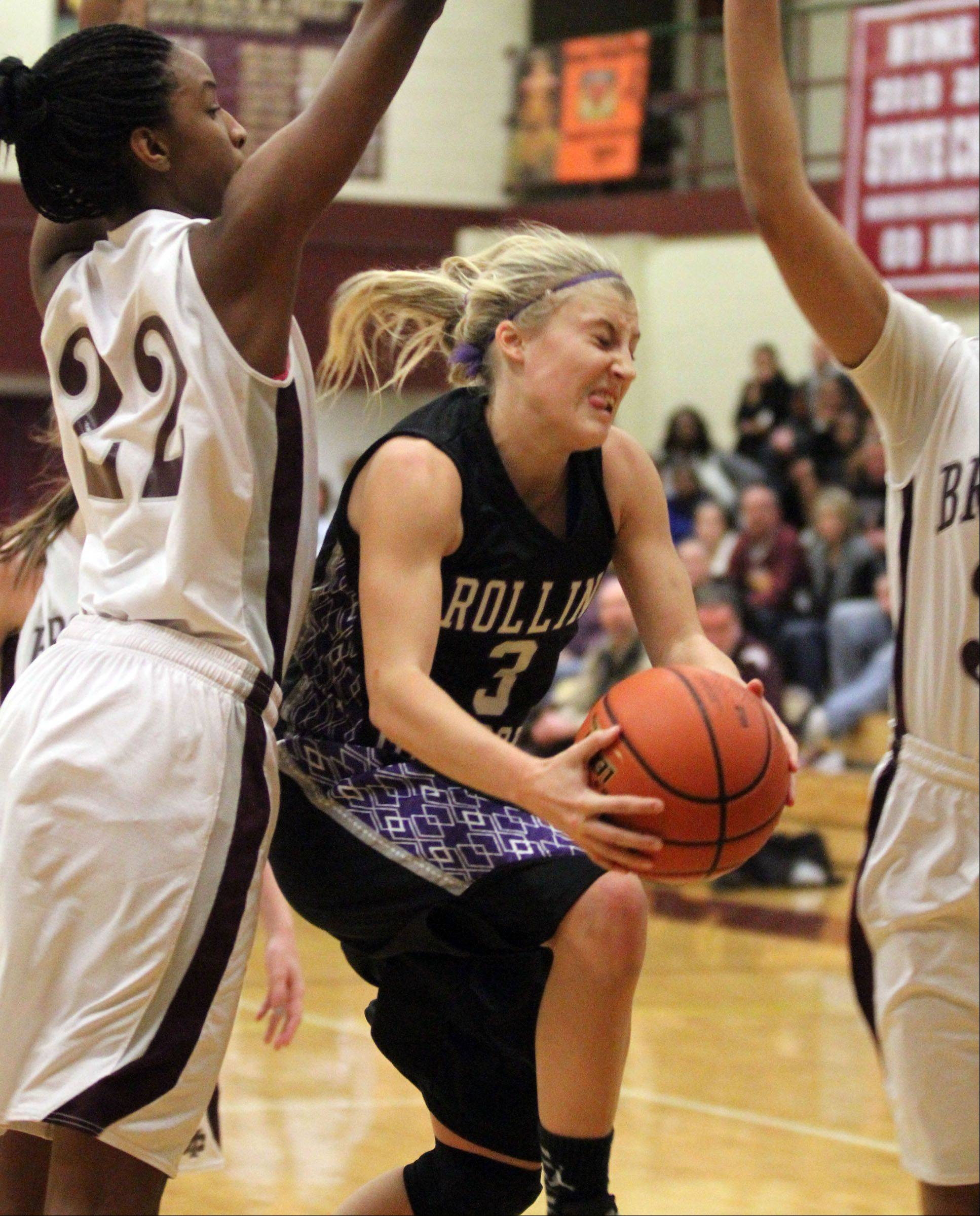 Rolling Meadows� Jackie Kemph shoots against Montini defender Malayna Johnson, left, in the championship game of the Montini holiday tournament in Lombard Saturday.