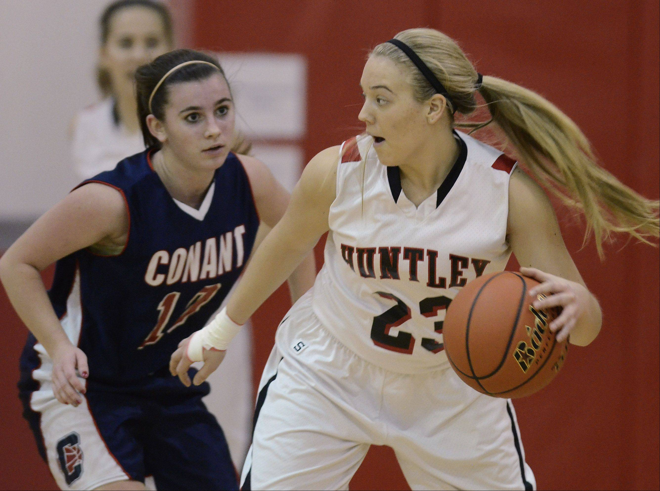 Huntley�s Taylor Stone, right, tries to dribble around Conant�s Sidney O�Keefe during Saturday�s game at Mundelein.