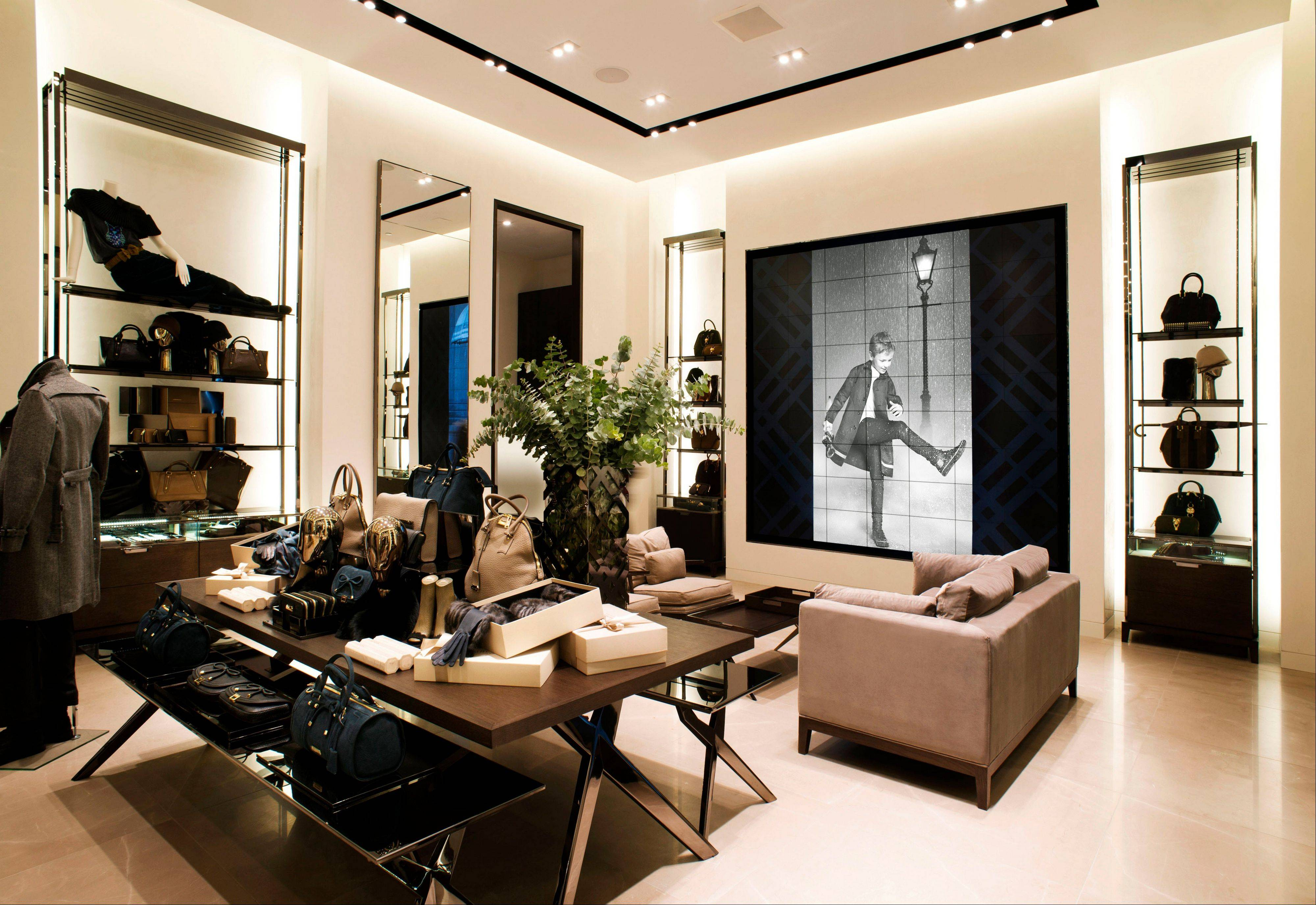 An interior view of the new Burberry flagship store on Michigan Avenue in Chicago. Burberry is interacting directly with consumers in the digital sphere too, launching projects like artofthetrench.com. The website invites users to upload pictures of themselves wearing BURBERRY trenchcoats.