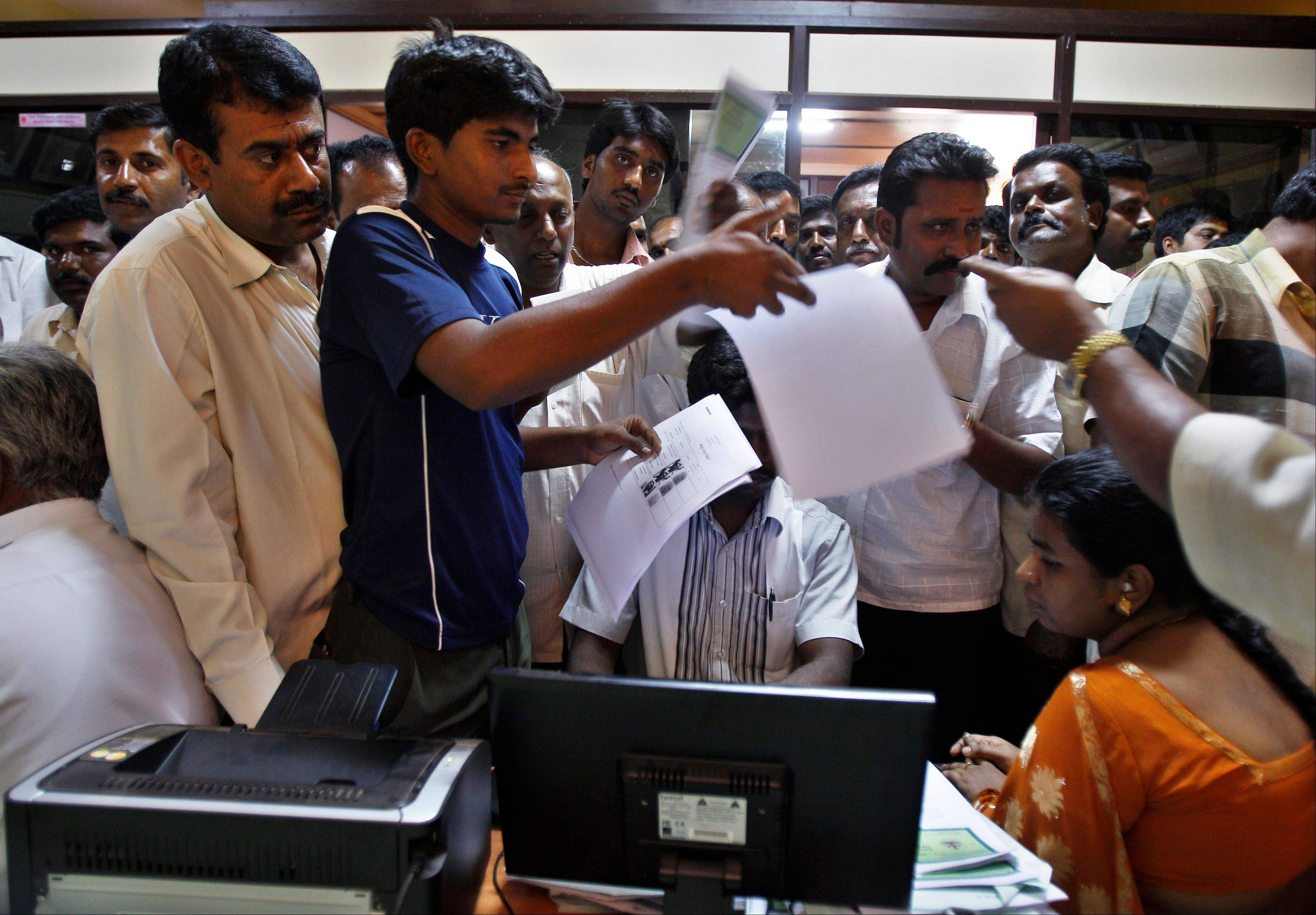 People crowd inside the government registrar's office to get their land registered, in Hoskote 19 miles from Bangalore in the southern Indian state of Karnataka. For years, Karnataka's land records were a quagmire of disputed, forged documents maintained by thousands of tyrannical bureaucrats who demanded bribes to do their jobs. In 2002, there were hopes that this was about to change.