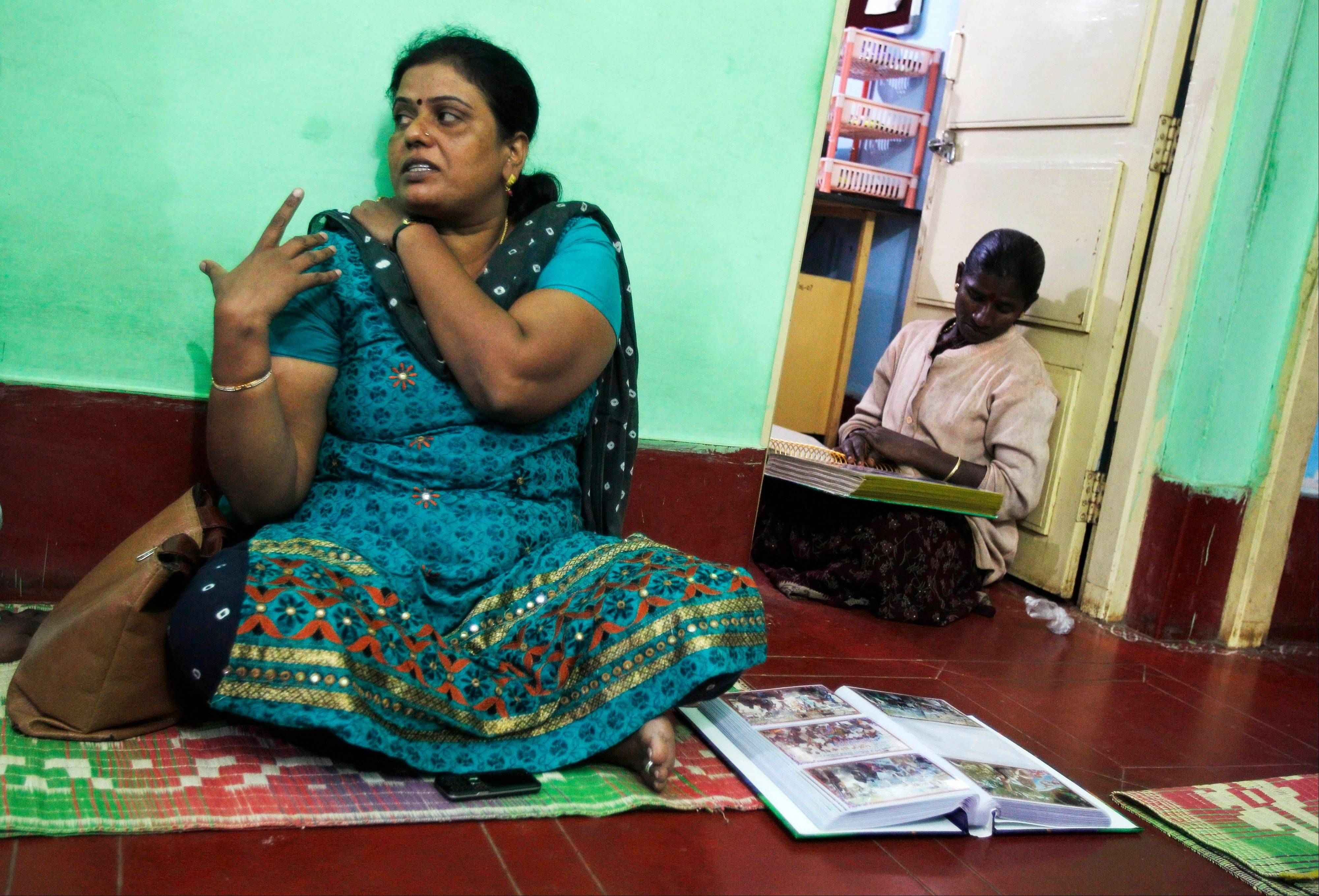 Yashoda Puttappa, left, a land rights activist, speaks to The Associated Press at her office in Anekal 40 25 miles from Bangalore in the southern Indian state of Karnataka.
