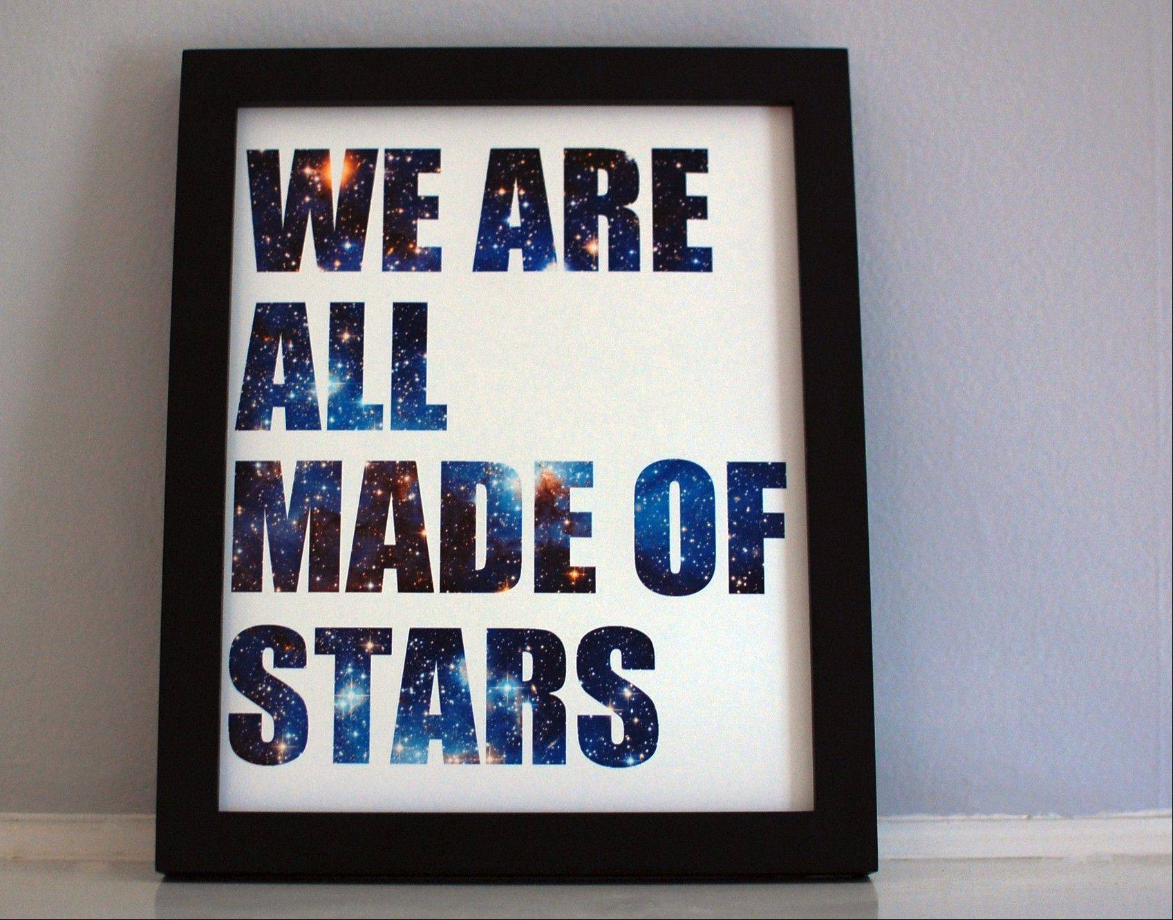 "This ""We Are All Made Of Stars"" framed print has letters composed of space images."