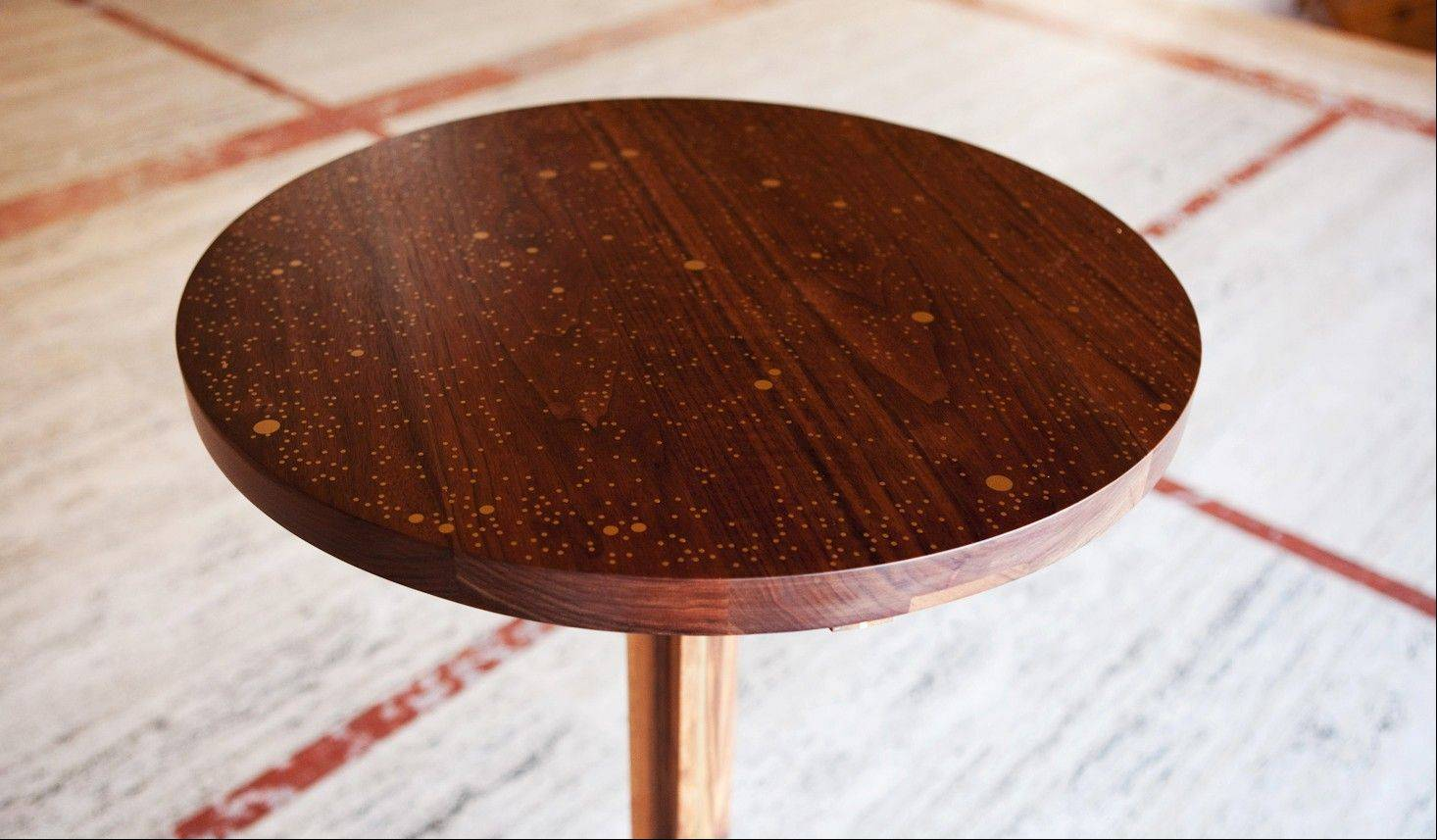 A Star Map walnut table is in the Serenade series, a group of tables built for the New York City Ballet that map the history of dance through the stars.