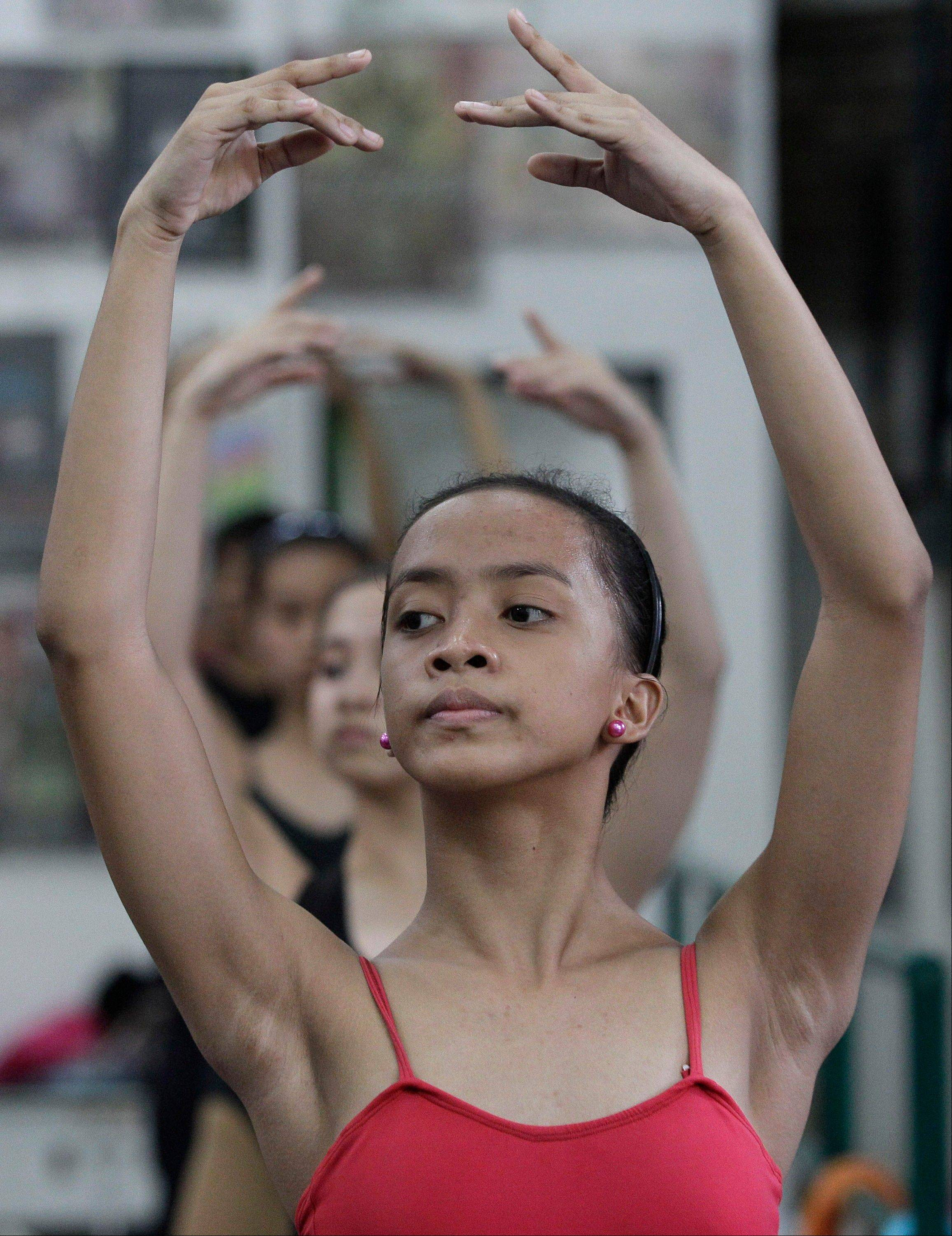 Jessa Balote rehearses during a class at Ballet Manila. Balote, who used to tag along with her family as they collect garbage at a nearby dumpsite, is a scholar at Ballet Manila's dance program.