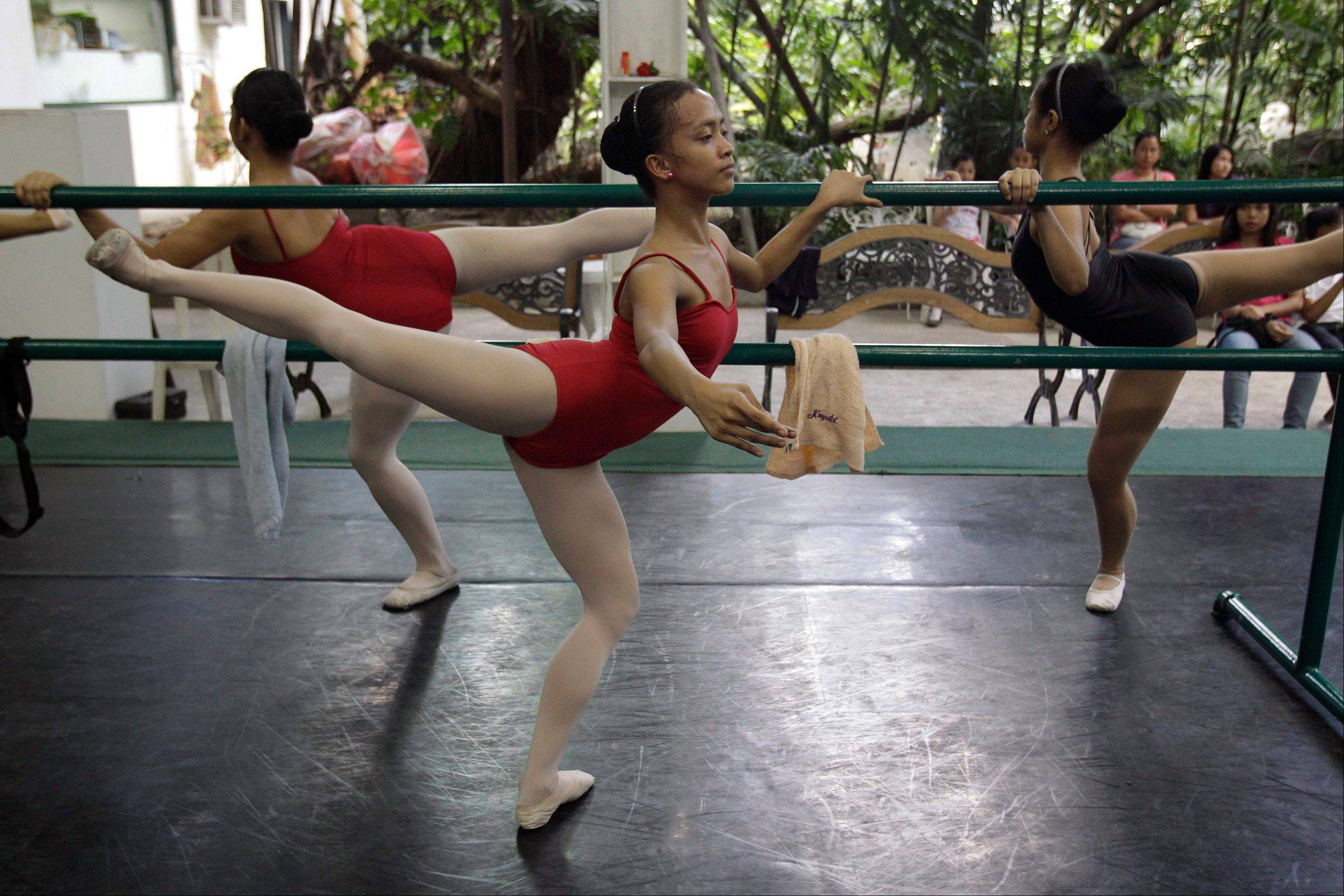 Jessa Balote, center, balances during a class at Ballet Manila.