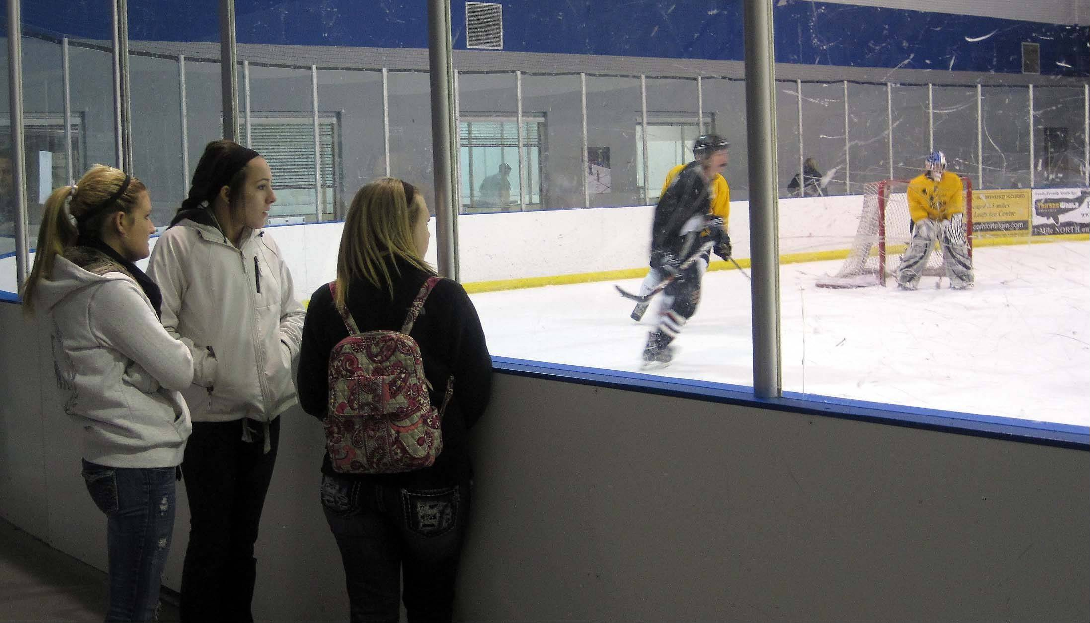 "About 40 people attended a ""Miracles for Moose"" benefit hockey game on Saturday at Leafs Ice Centre in West Dundee to raise funds for the family 18-year-old Anthony ""Moose"" Mustari, of Crystal Lake, who is battling a rare form of leukemia. Pictured are, from left, Lexi Martin, Claire Pipia and Sunny Ladehoff, all juniors at Prairie Ridge High School, from which Anthony graduated this summer."
