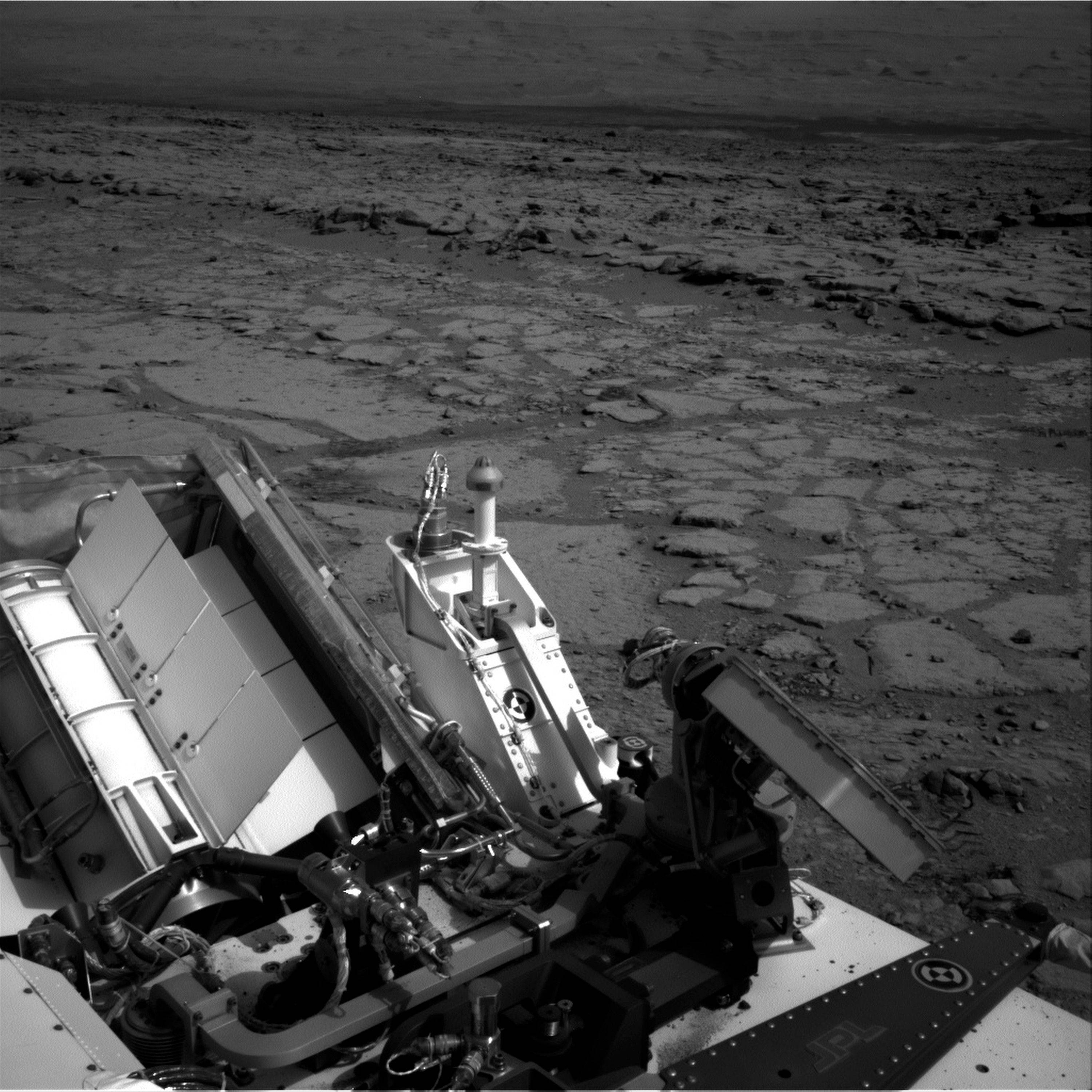 "NASA's Mars rover Curiosity takes a pit stop, at a shallow depression called ""Yellowknife Bay."""