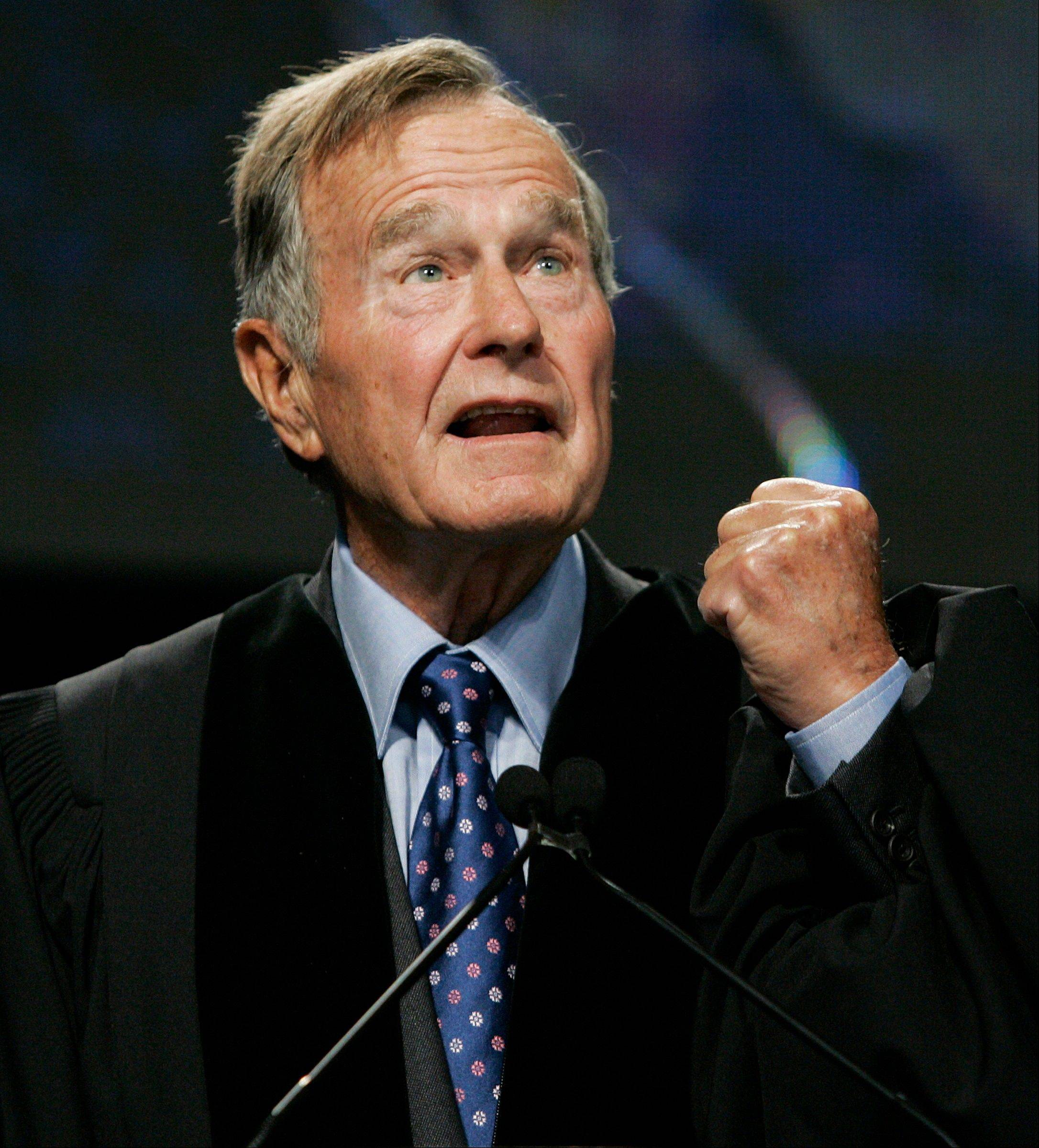 Ex-President George H.W. Bush delivers the keynote speech before receiving an honorary Doctor of Public Administration degree at Suffolk University in Boston.