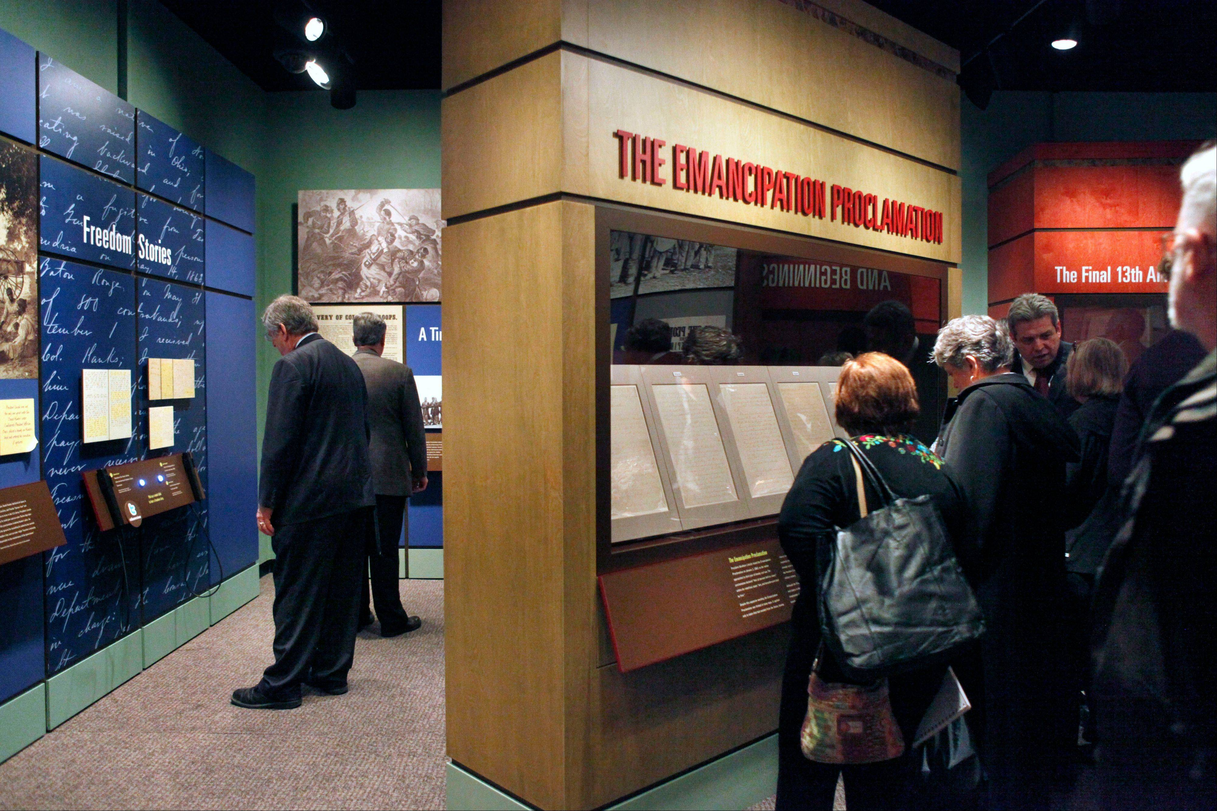 National Archives visitors looking at a display of President Abraham Lincoln's Emancipation Proclamation.