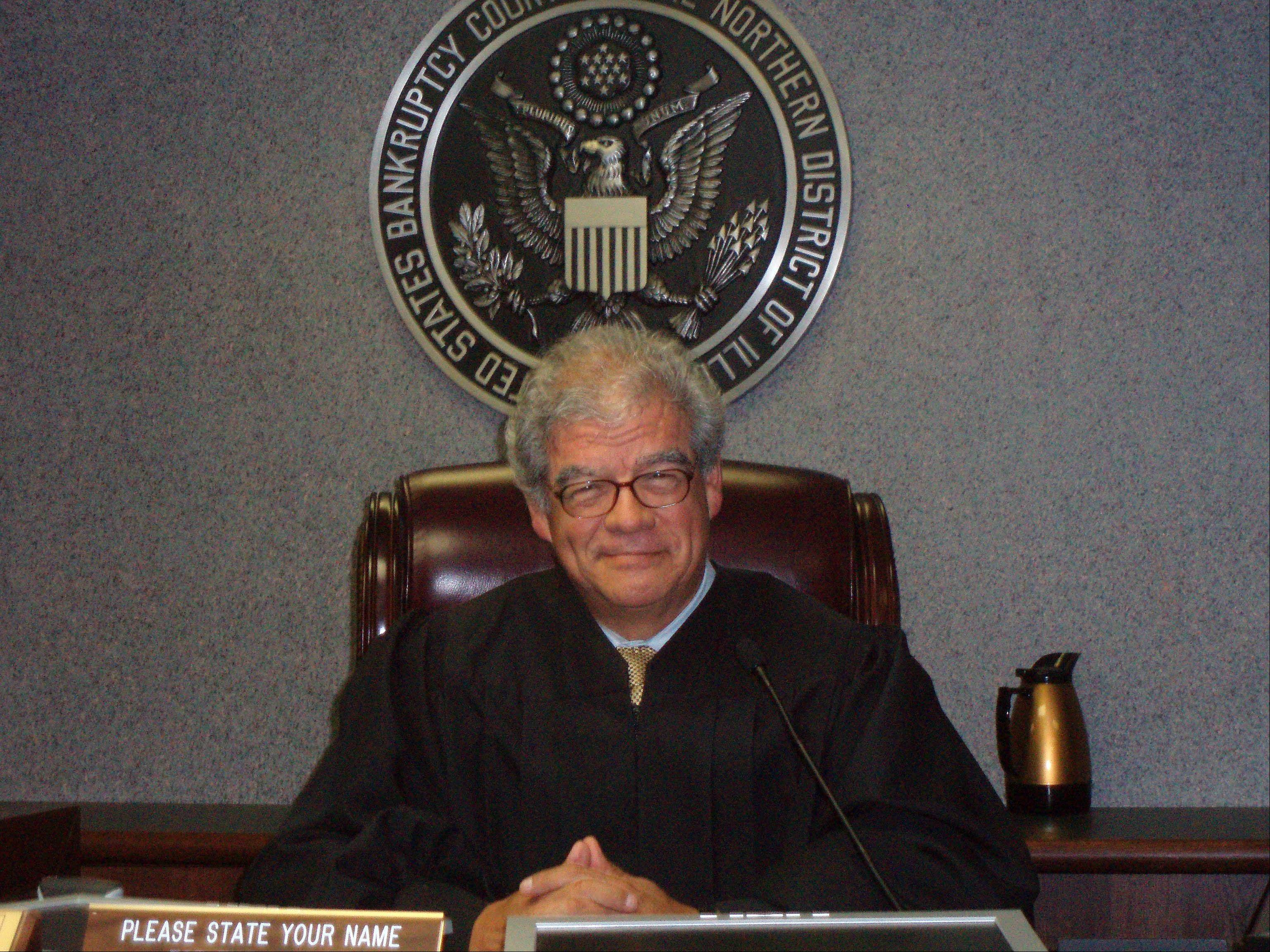 Federal bankruptcy Judge Manuel Barbosa, of Elgin, came to the U.S. with his migrant worker parents when he was 2 months old. He retired Friday.