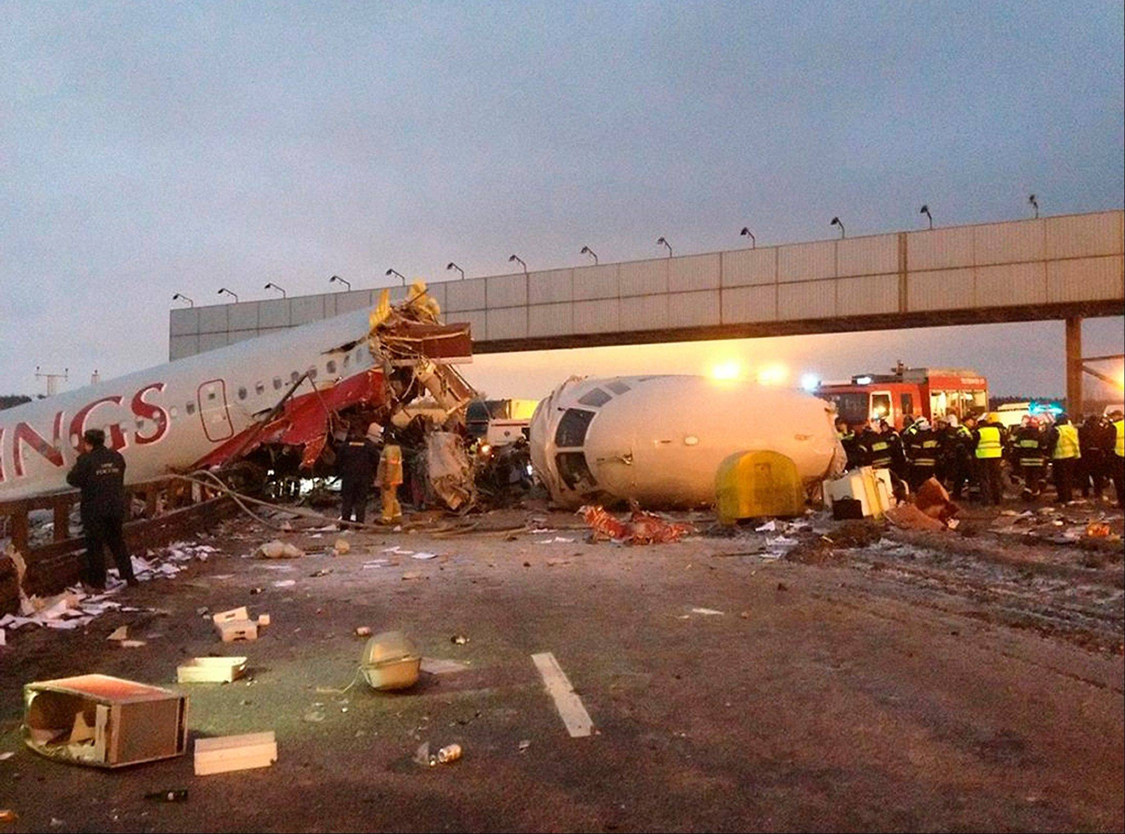 Rescuers work Saturday at the site of a plane crash at Vnukovo Airport in Moscow.