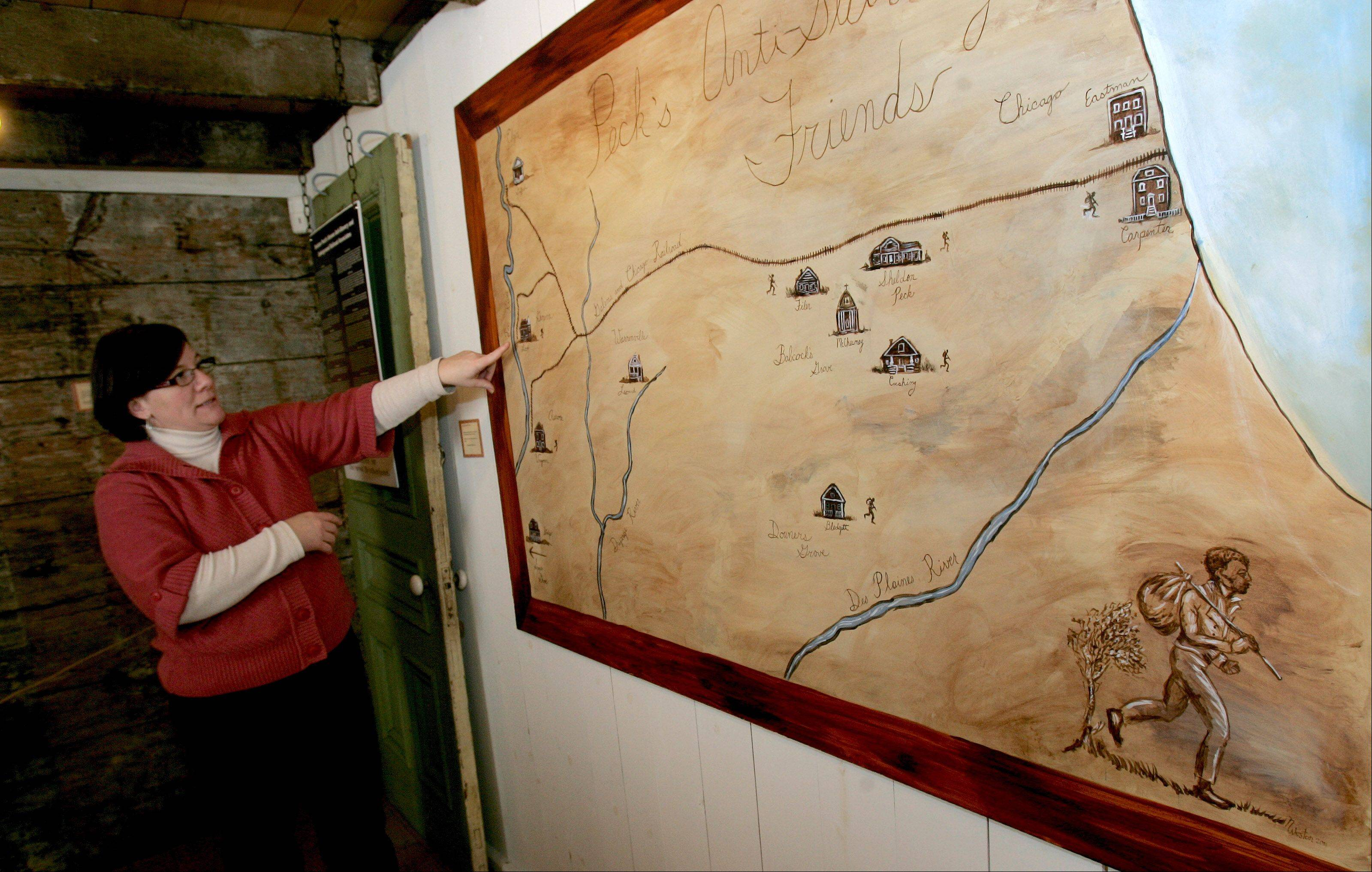 Jeanne Schultz Angel, executive director of the Lombard Historical Society, examines a map depicting northern Illinois sites on the Underground Railroad.