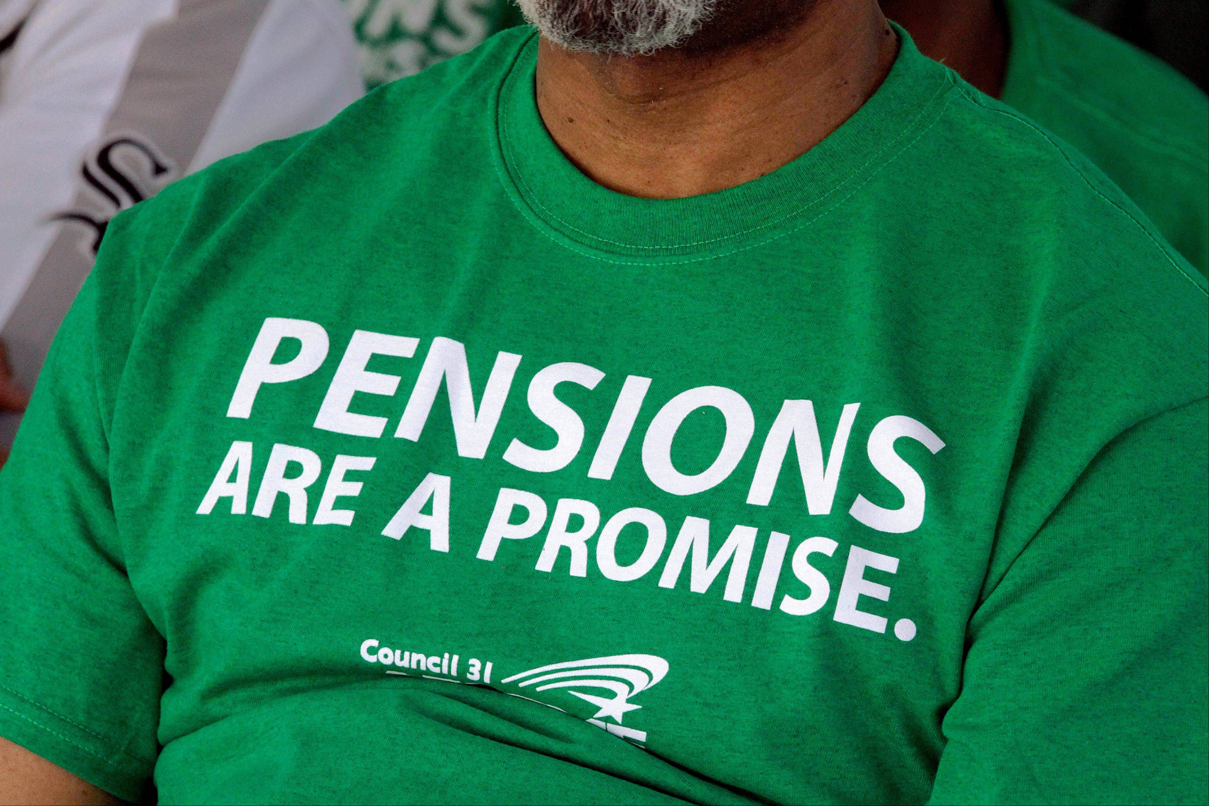 A member of the American Federation of State County and Municipal Employees wears a protest message on his shirt while rallying against new pension rules at the Illinois state Capitol in Springfield.
